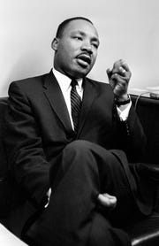 Dr. Martin Luther King Jr. speaks before a news conference in Nashville on May 17, 1962. The integration leader chided President John F. Kennedy, saying he did not raise his voice to get the administration's literacy test bill passed in the Senate.