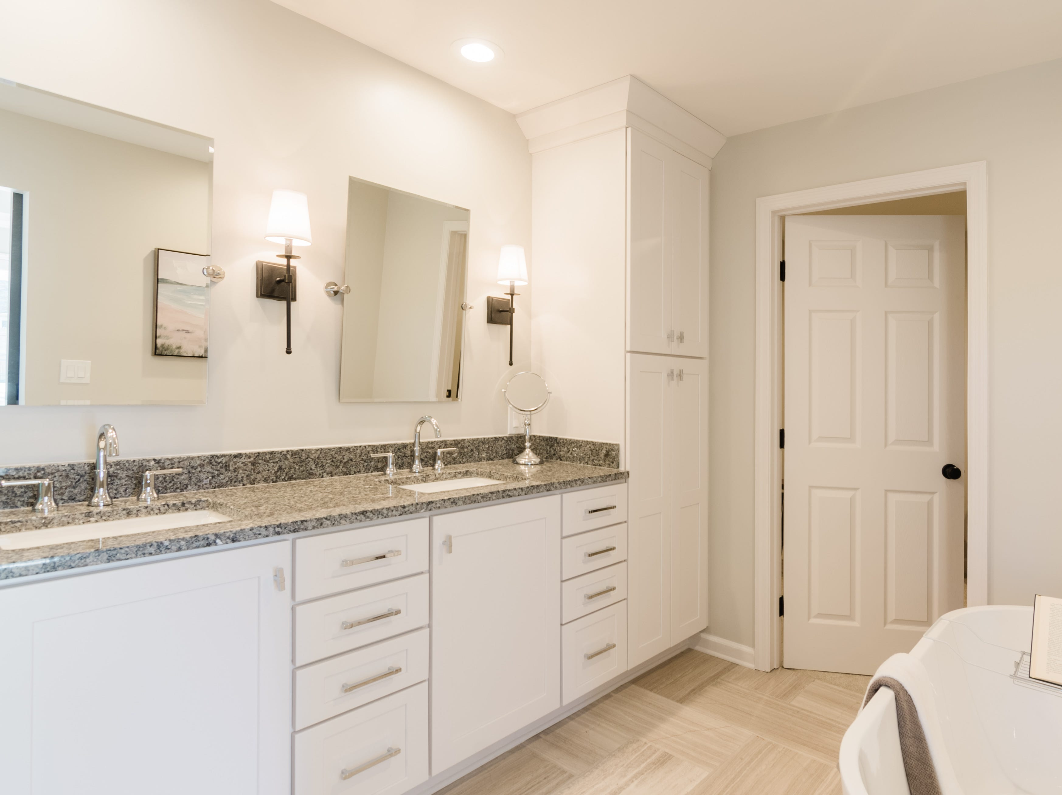 AFTER: The master bath at 405 Oakvale was opened up, expanded and now features ample lighting and cabinet space.