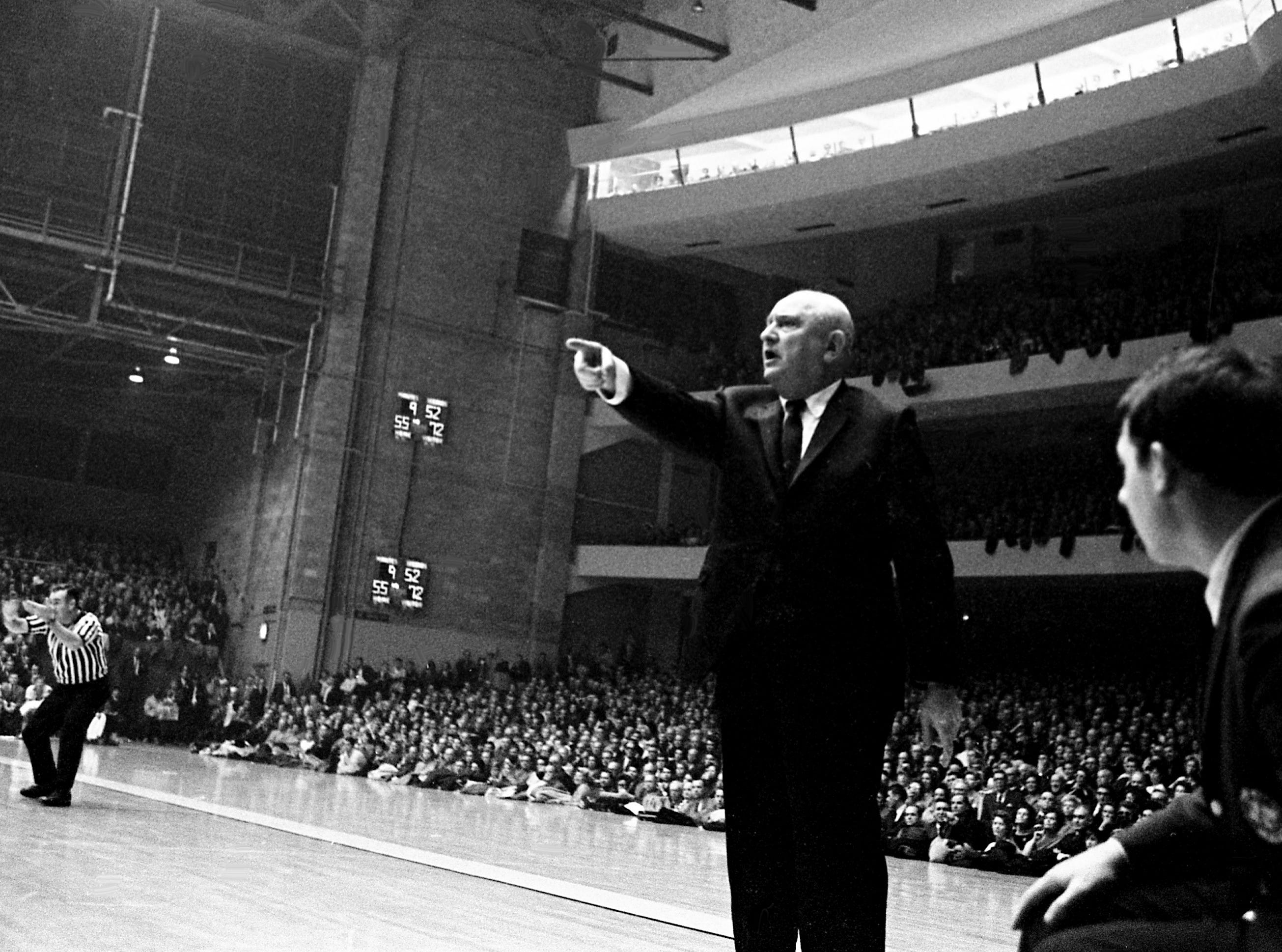 Kentucky master coach Adolph Rupp, who was given a standing ovation by the Vanderbilt crowd prior to the game, is directing his team to a 94-78 victory over the Commodores at Memorial Gym Jan. 6, 1968.