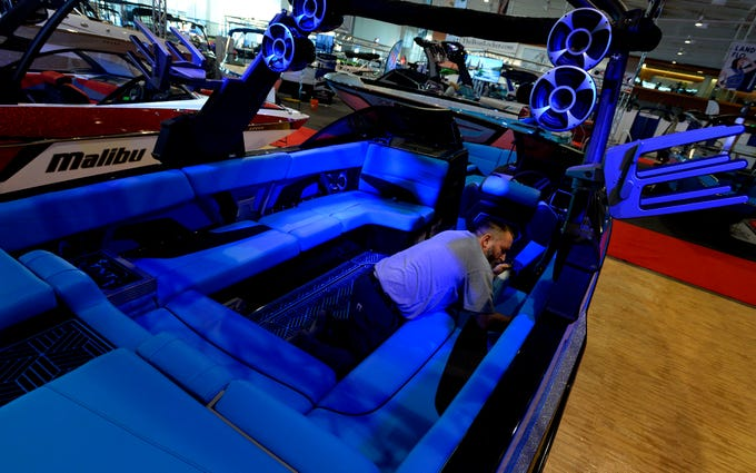 Lou Dimino of TNT Watersports cleans the inside of a Malibu 24mxz boat in preparation for the Nashville Boat Show at the Music City Center Wednesday, Jan. 9, 2019, in Nashville, Tenn.