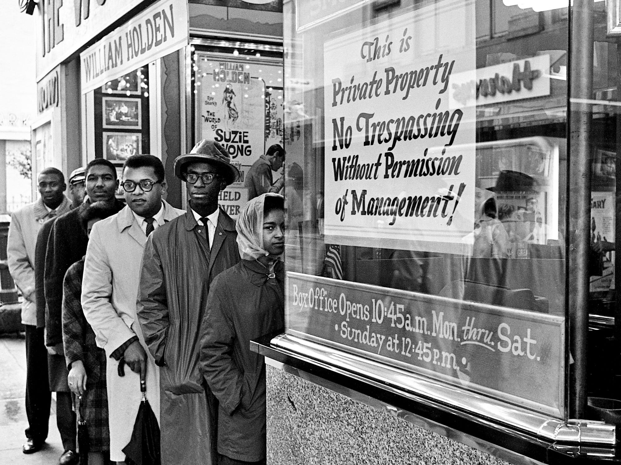 A small group of demonstrators, mostly black college students, try to gain admittance to the Tennessee Theater in downtown Nashville on Feb. 21, 1961. Aiding the students is the Rev. James Lawson, third from right.