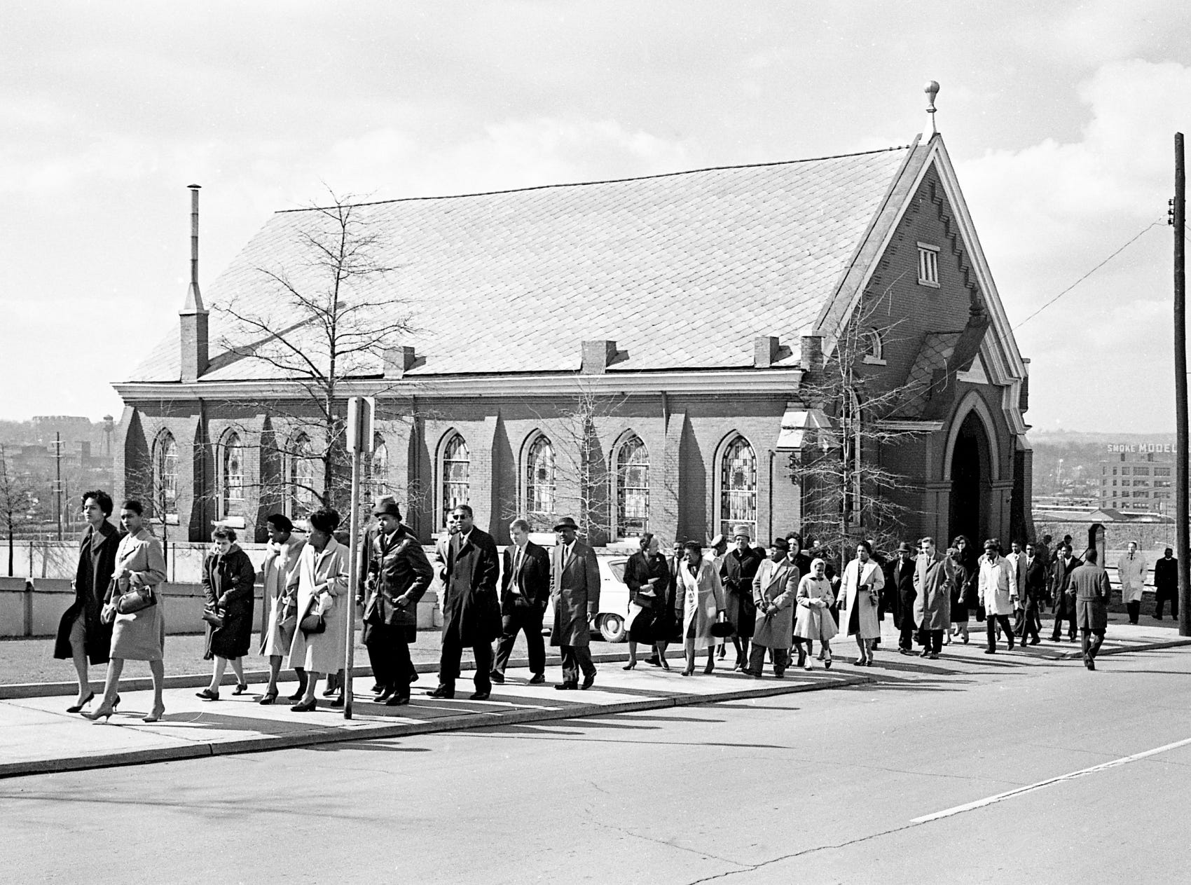 About 60 black and white demonstrators leave the First Baptist Church at Eighth Avenue North to march two-and-a-half blocks to protest the segregation policy of the YMCA building Feb. 24, 1963.