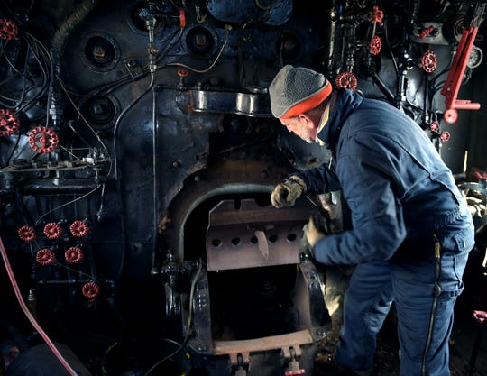 Byrom Stacey works on steam locomotive No. 576 before on Jan. 27, 2017 at Centennial Park where the locomotive has been on display for 65 years.