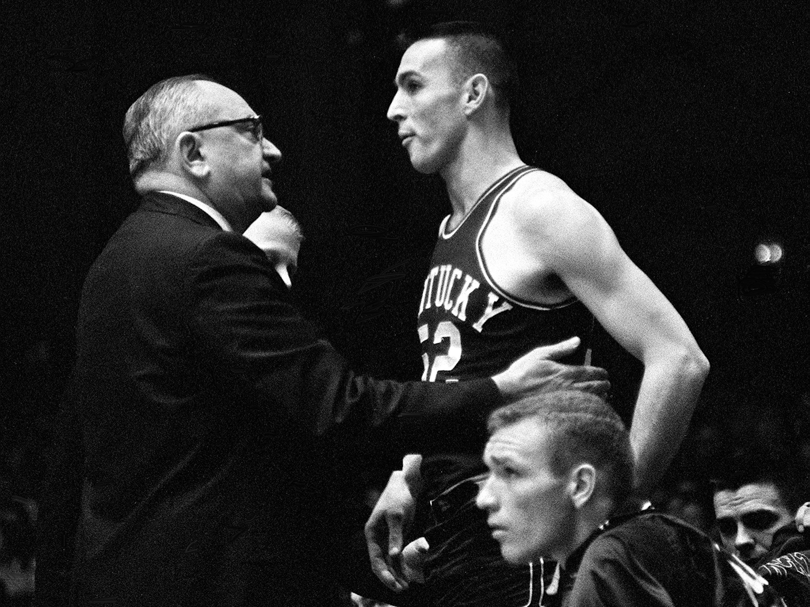 Kentucky head coach Adolph Rupp, left, talks with one of his players before sending him into the game against Vanderbilt Jan. 9, 1961. The Wildcats became the Commodores' 11th straight victim, falling 64-62 before 7,324 fans at Memorial Gym.