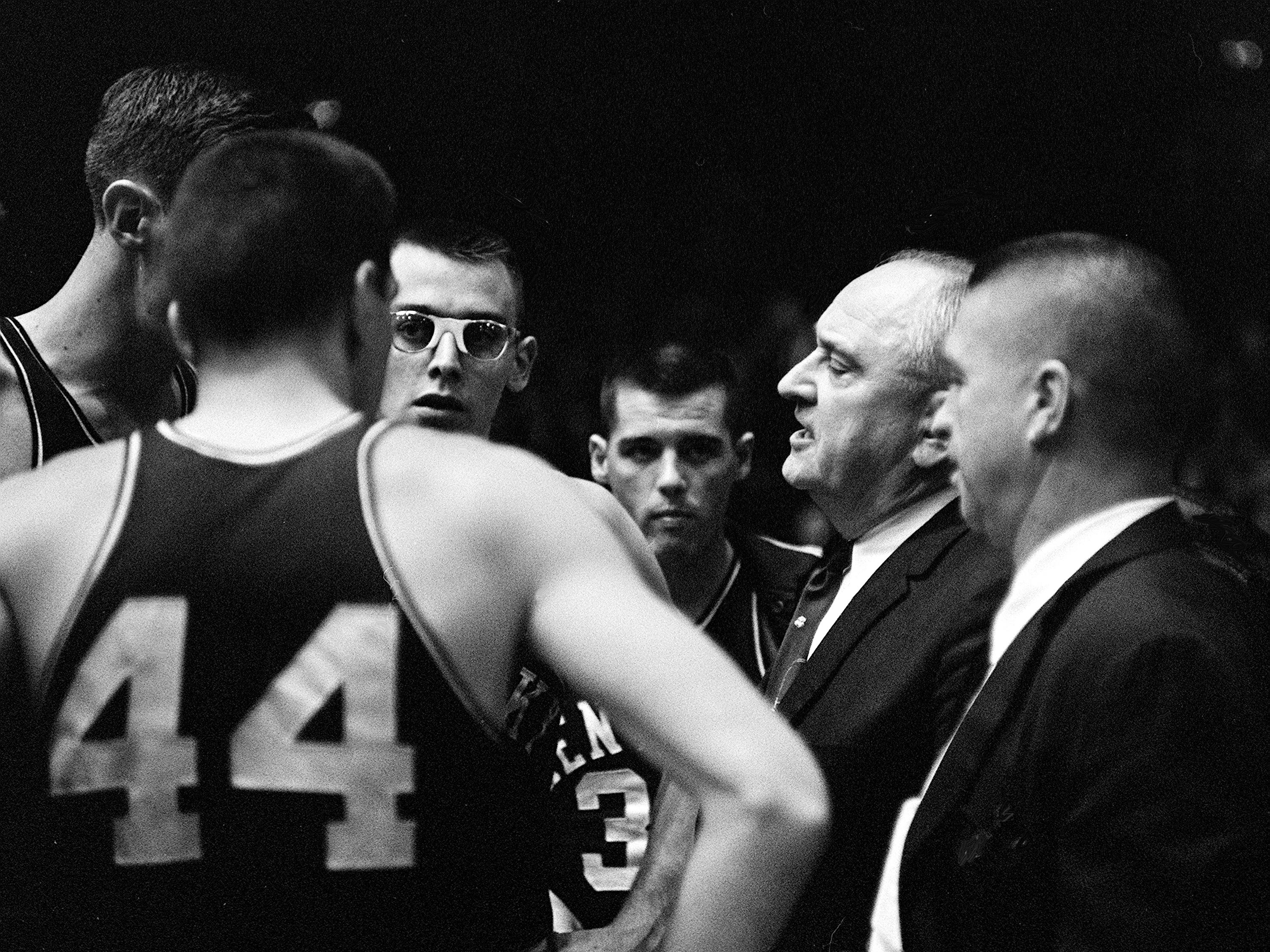 Kentucky head coach Adolph Rupp, second from right, talks with his players during a timeout against Vanderbilt Jan. 9, 1961. The Wildcats became the Commodores' 11th straight victim, falling 64-62 before 7,324 fans at Memorial Gym.