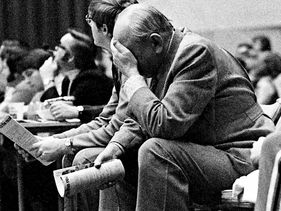 Coach Adolph Rupp holds his head in disbelief over some of the antics of his team during the Kentucky-Tennessee All-Star game April 1, 1972. But the Baron took home all the marbles with a 102-96 win over the Tennessee charges, coached by Vanderbilt's Roy Skinner.