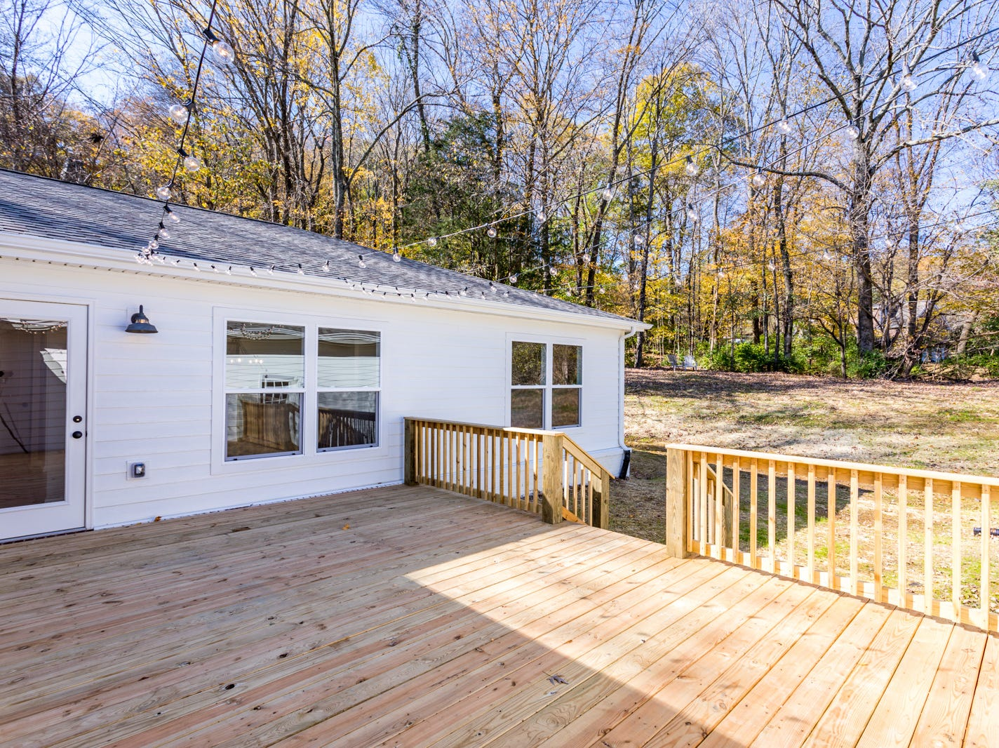 AFTER: This remodeled ranch home for sale at 1104 Chelsey Court in Brentwood has a large back porch and wooded lot.
