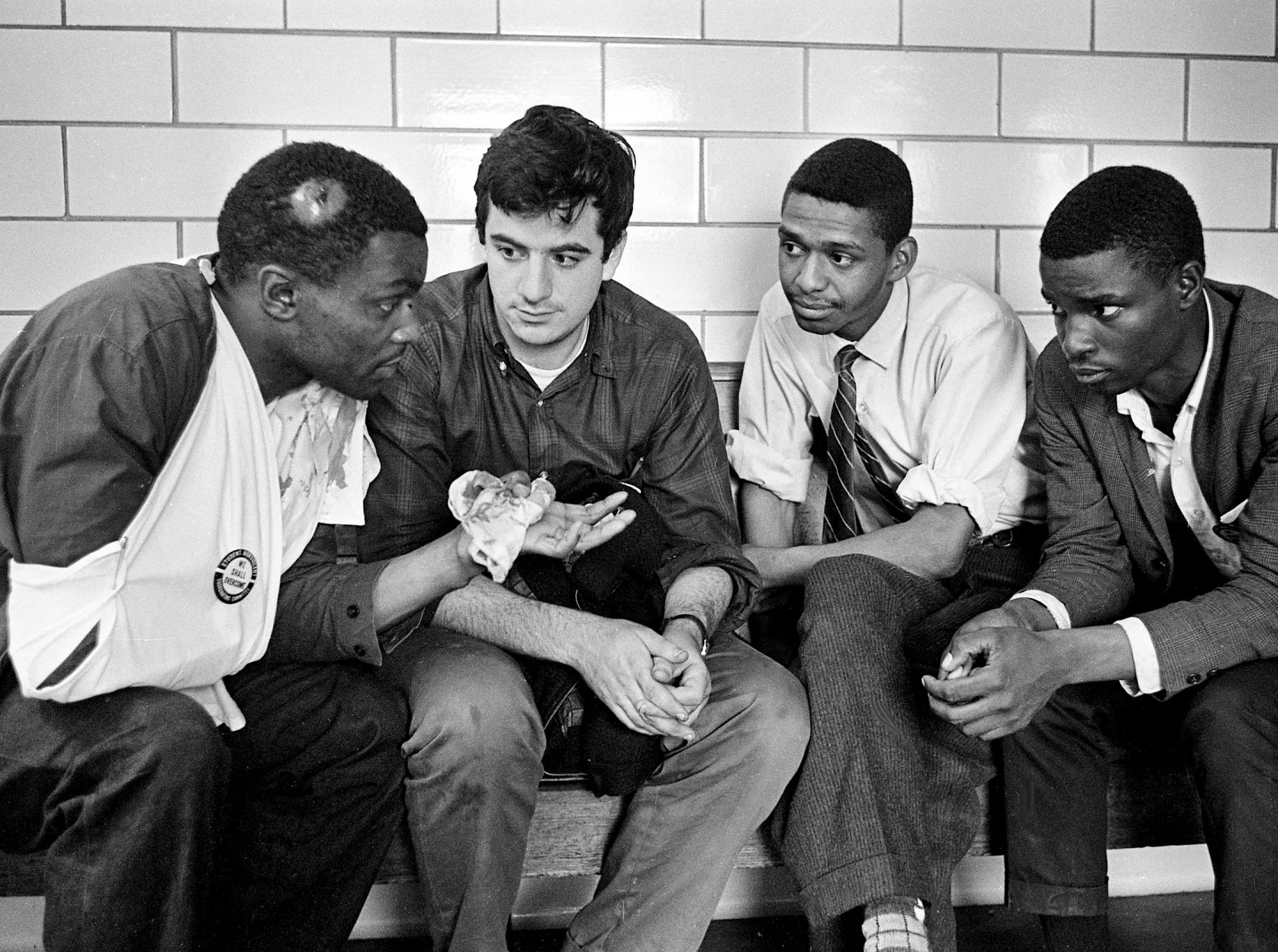 Civil rights demonstrators sit in Metro jail April 27, 1964, as they wait to make bond. They are Lester McKinnie, left, a group leader; Allen Wolfe, a Vanderbilt student; William T. Barbee, a Scarritt student; and Frederick Leonard, a student at Tennessee A&I. McKinnie was subdued by police and was treated for injuries at General Hospital.