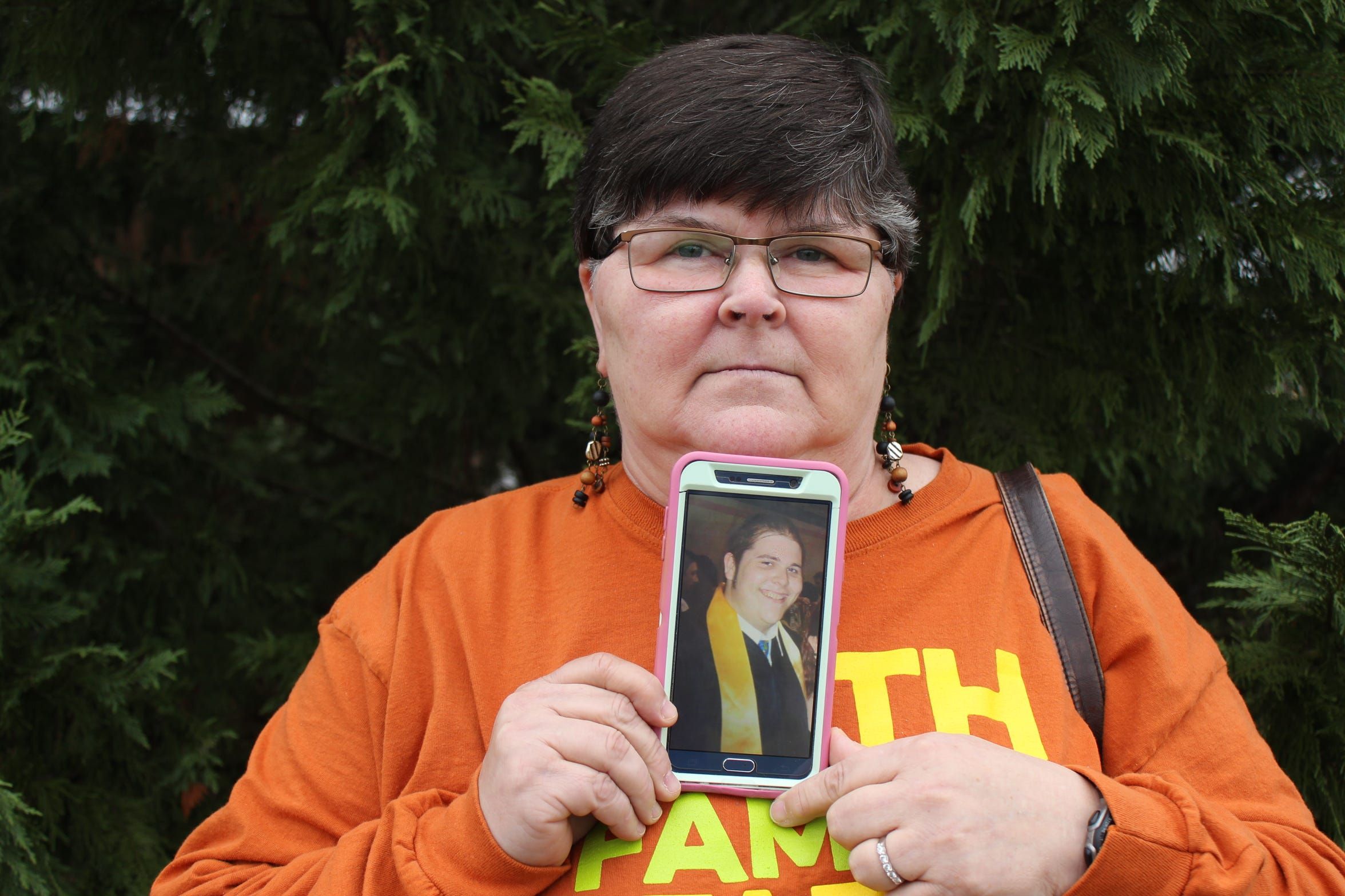 "Bonnie Blackburn holds a photo of her son, Mathew Blackburn, one of five patients of Dr. Darrel Rinehart who died within an 11-month span. ""It's wrong,"" Blackburn said. ""He needs to go to jail, and he should never be able to practice again."""
