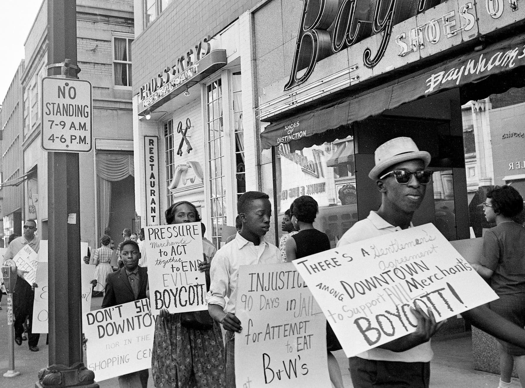 "Demonstrators march through the downtown area to picket businesses that practice racial discrimination March 30, 1963. There were about 60 participants in the ""Freedom March,"" the second of its kind in Nashville in the past eight days. Some of the places they hit were the B&W Cafeteria, Cross Keys, Wilson-Quick Pharmacy, Harvey's and Cain-Sloan's."