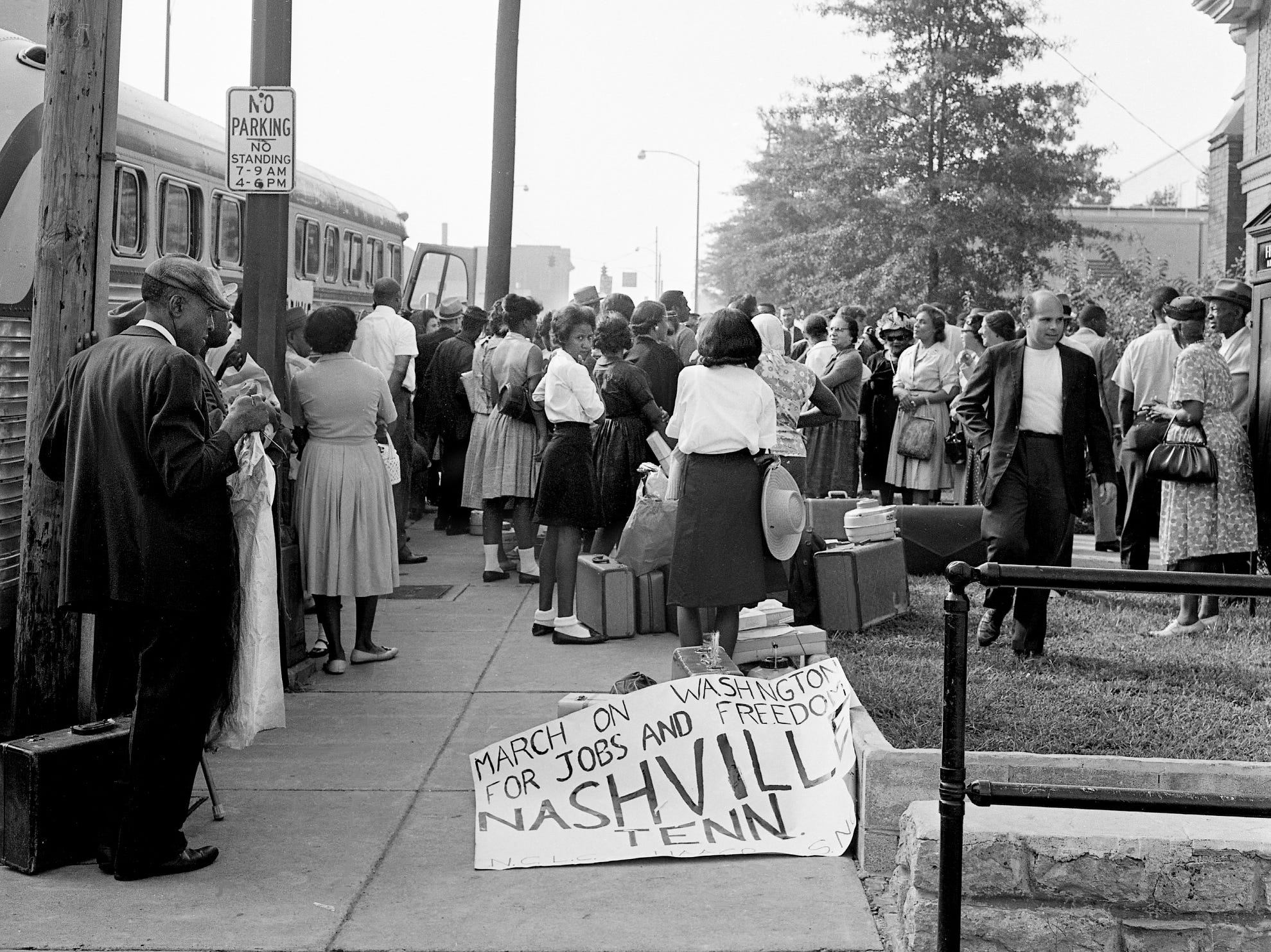"A group of Nashvillians board buses Aug. 27, 1963, at First Baptist Church downtown for a trip to Washington, D.C., for the ""march for jobs and freedom."" They were part of 200,000 who gathered at the Lincoln Memorial and heard the Rev. Martin Luther King Jr.'s famous ""I Have a Dream"" speech."