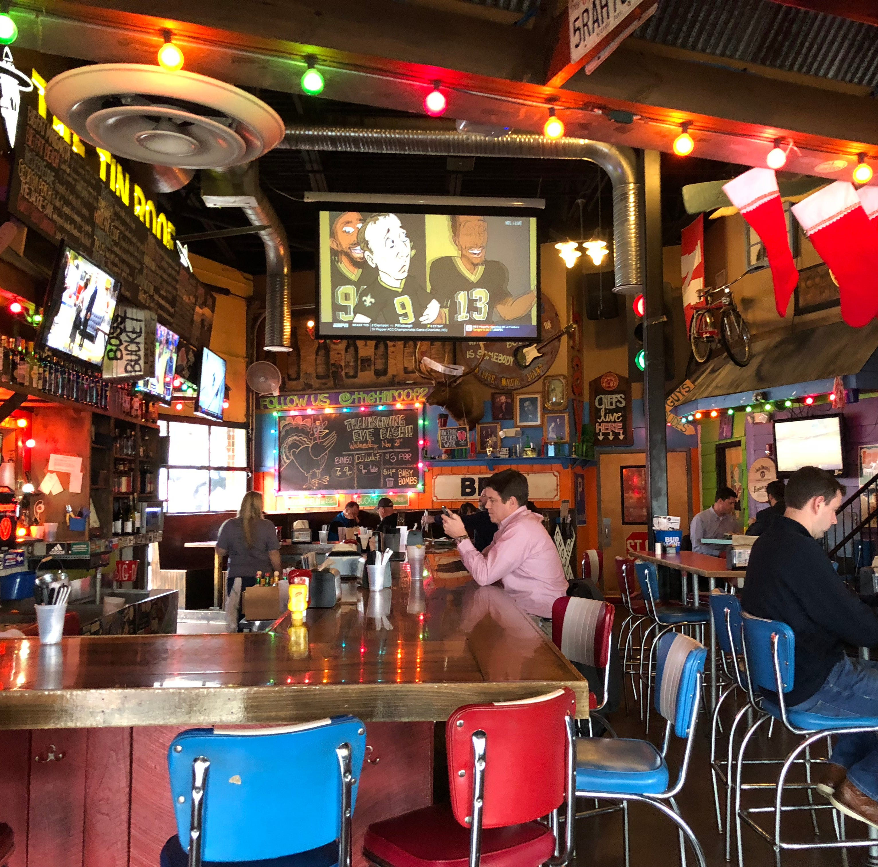 The interior space at Tin Roof 2 is festive and...