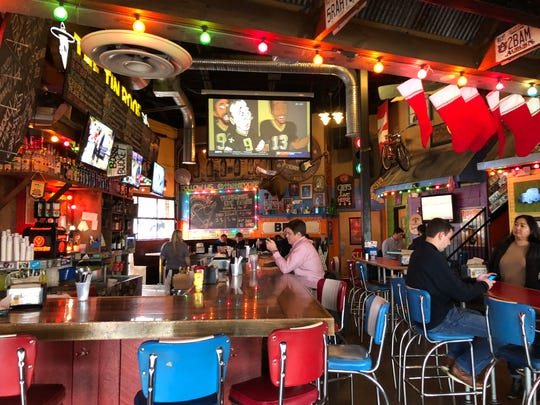 The interior space at Tin Roof 2 is festive and fun, even at lunchtime. You can sit at the bar and watch a game or grab a booth with friends or coworkers.