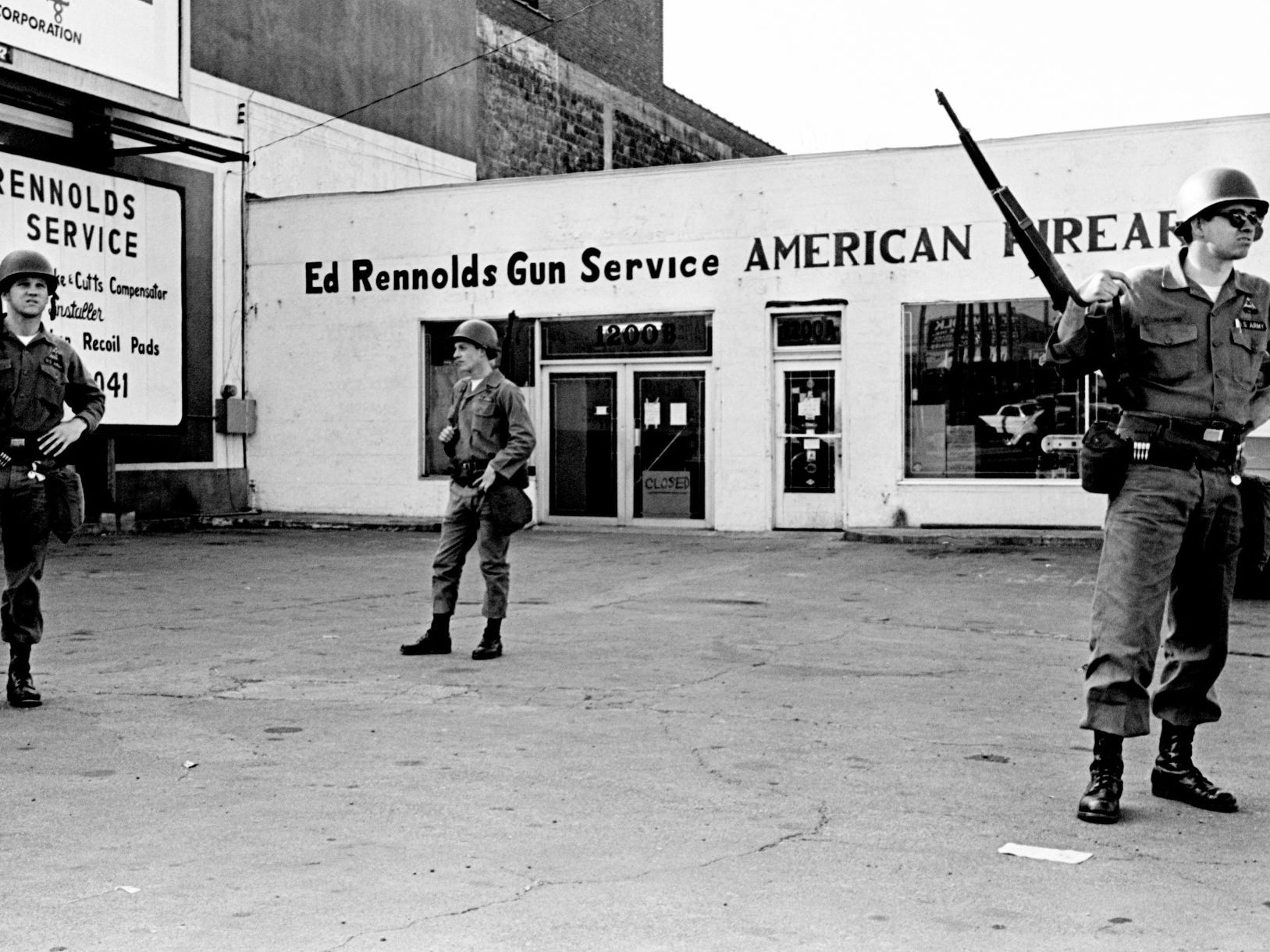 Three National Guardsmen stand on duty at Ed Rennolds Gun Service and American Firearms on 12th Avenue in Nashville on April 6, 1968.
