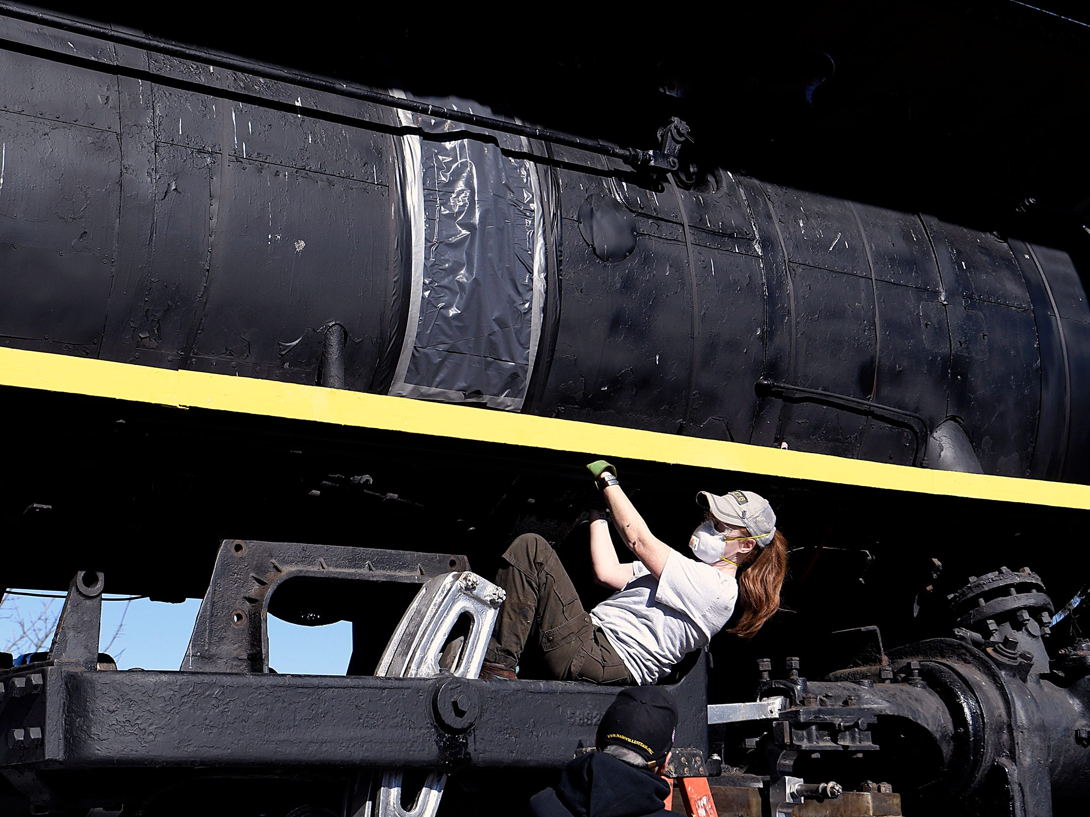 Volunteer Rebecca Bender works on the steam locomotive  No. 576 on Saturday, ja. 6, 2019 before it leaves its longtime home at Centennial Park. No. 576 is being to be moved and then restored to return to the tracks.