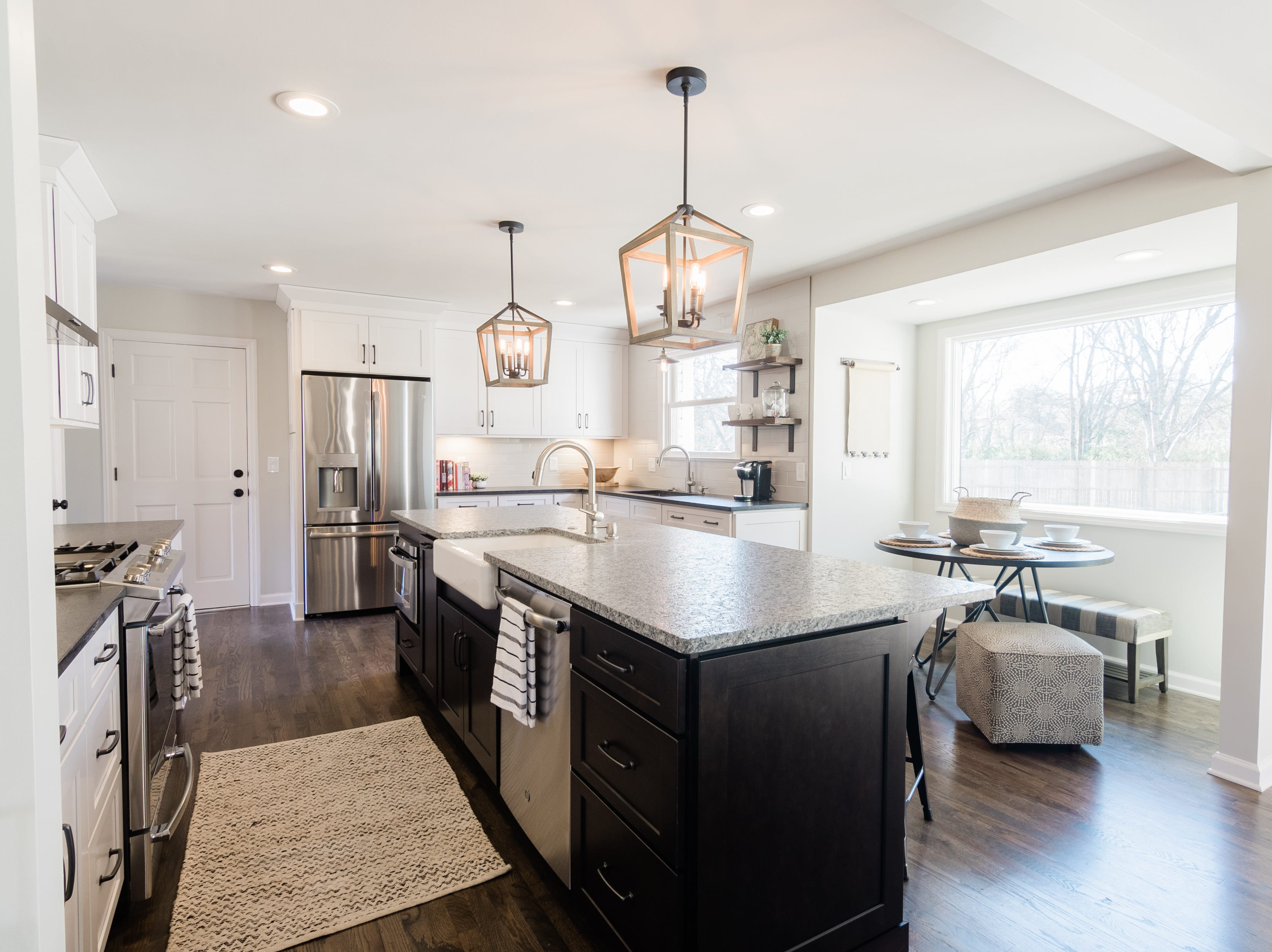 AFTER: With the wall gone that originally separated the kitchen from the living area (to the right of the breakfast nook) the kitchen at 405 Oakvale feels larger and now flows into the rest of the home's open floor plan.