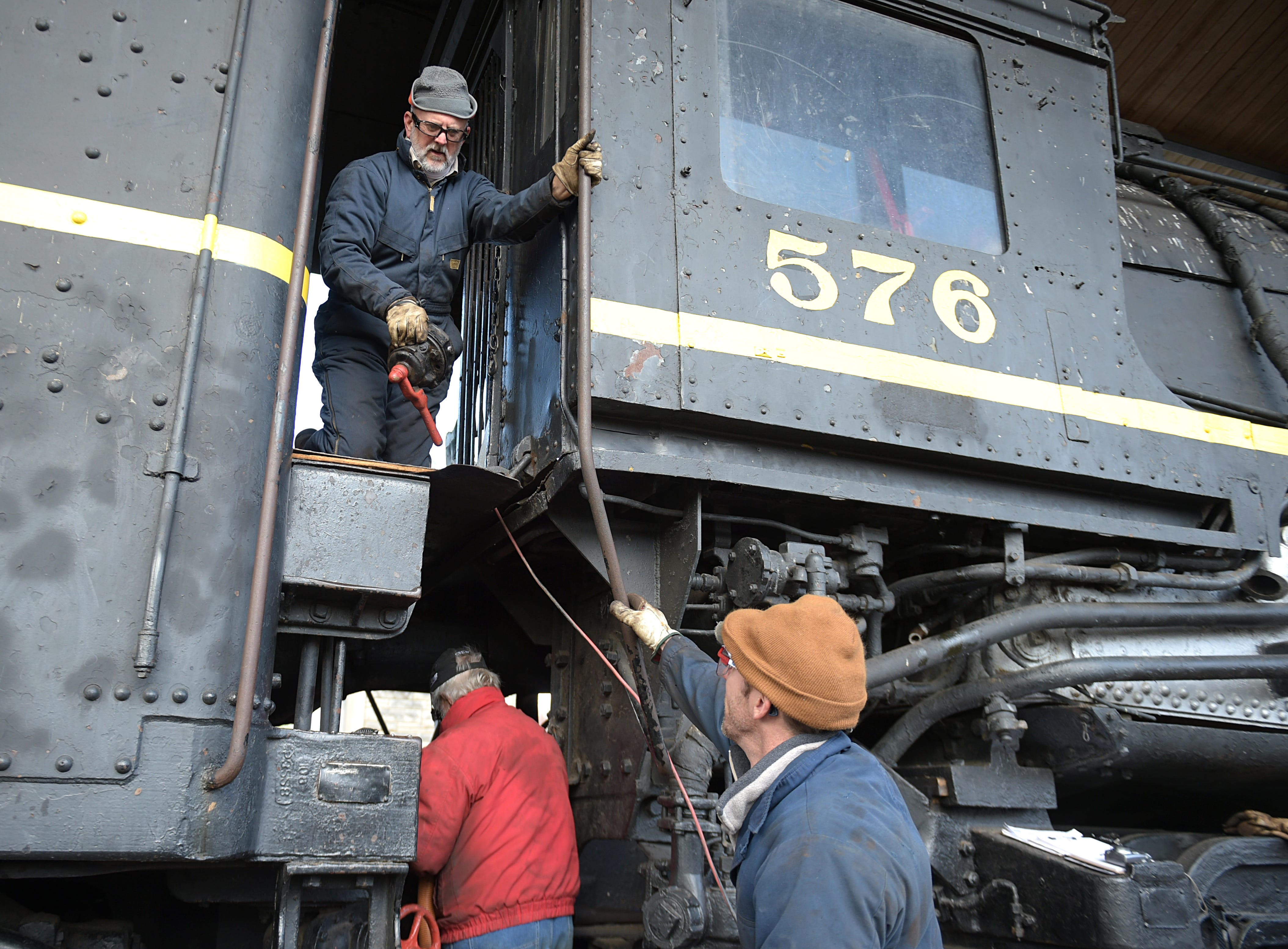 Byrom Stacey and other volunteers works on steam locomotive No. 576 before on Jan. 27, 2017 at Centennial Park where the locomotive has been on display for 65 years.