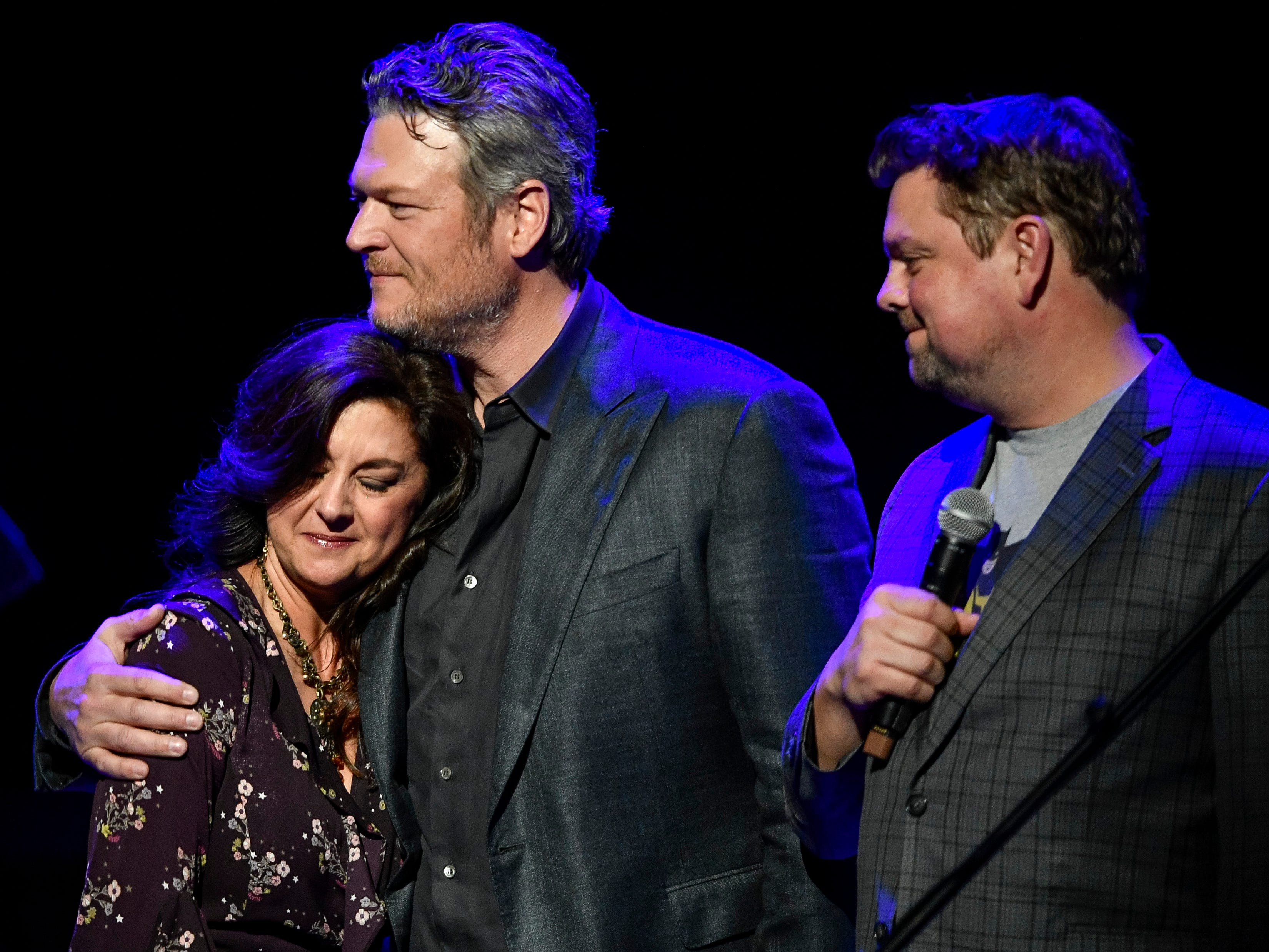 Angie Gentry is hugged by Blake Shelton during the C'Ya On The Flipside Benefit Concert at the Grand Ole Opry House in Nashville, Tenn., Wednesday, Jan. 9, 2019.