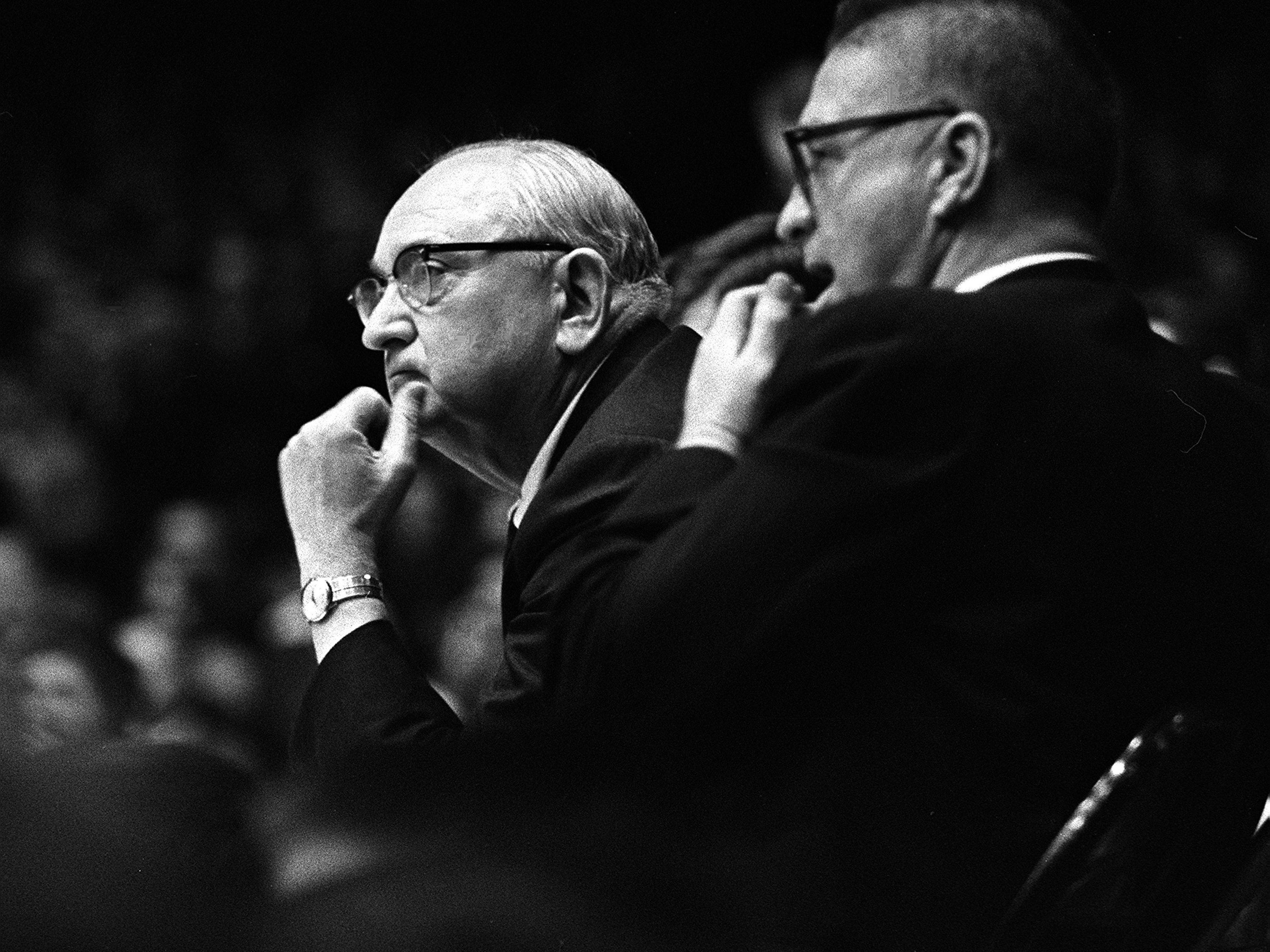 Kentucky head coach Adolph Rupp, left, keeps an eye on the action in their game at Vanderbilt. The undefeated Wildcats won 105-90 over the Commodores before more than 9,500 fans in Memorial Gym Feb. 2, 1966.
