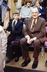 Chip Rupp, left, sits with his grandfather Adolph Rupp, the iconic Kentucky basketball coach, at a Wildcats' game in the 1970s.