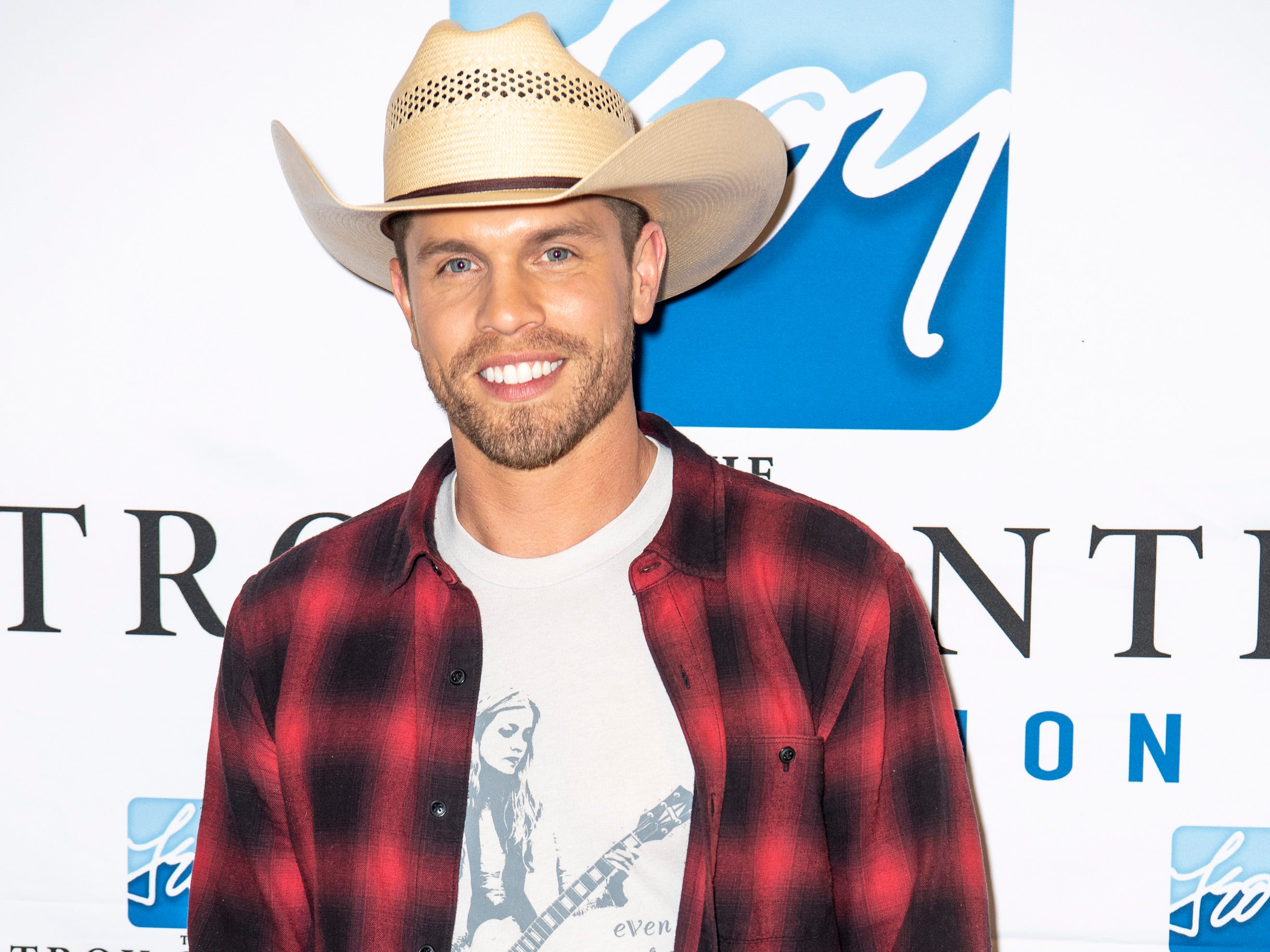 Dustin Lynch on the red carpet before the C'Ya On The Flipside Benefit Concert at the Grand Ole Opry House in Nashville, Tenn., Wednesday, Jan. 9, 2019.