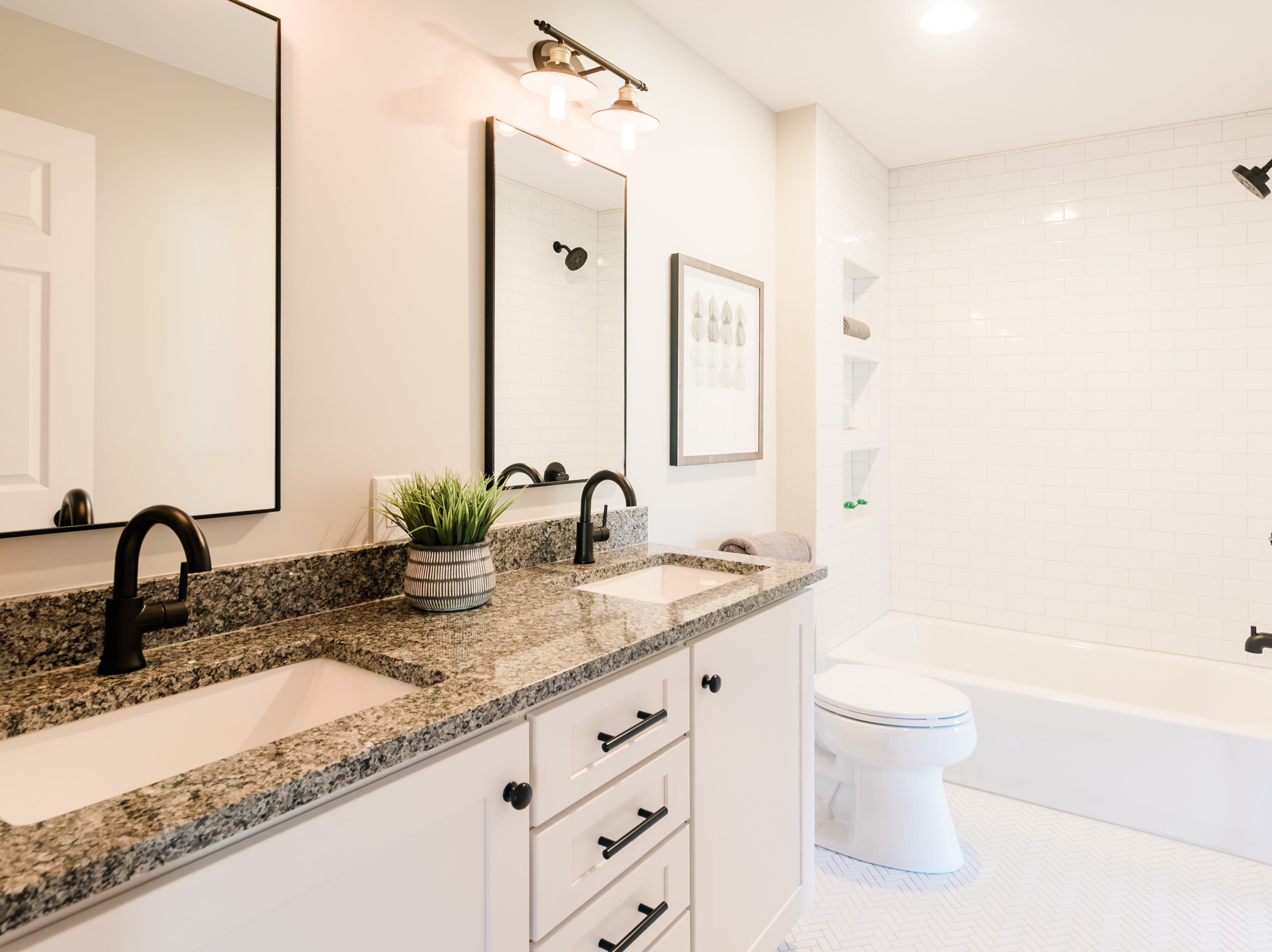 AFTER: When the home at 405 Oakvale was remodeled, designers at Design Hive re-imagined the space, opened it up and made it feel like a new home master bath.
