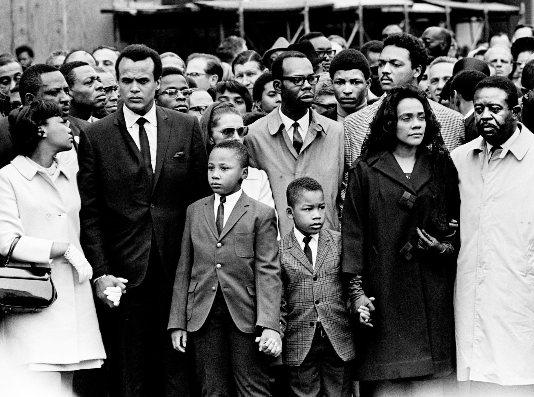 Getting ready for the silent march from Clayborn Temple to city hall in Memphis on April 8, 1968, are Yolanda King, left, Harry Belafonte, Martin Luther King III, Dexter King, Coretta Scott King and the Rev. Ralph Abernathy. Behind the widow is the Rev. Jesse Jackson.