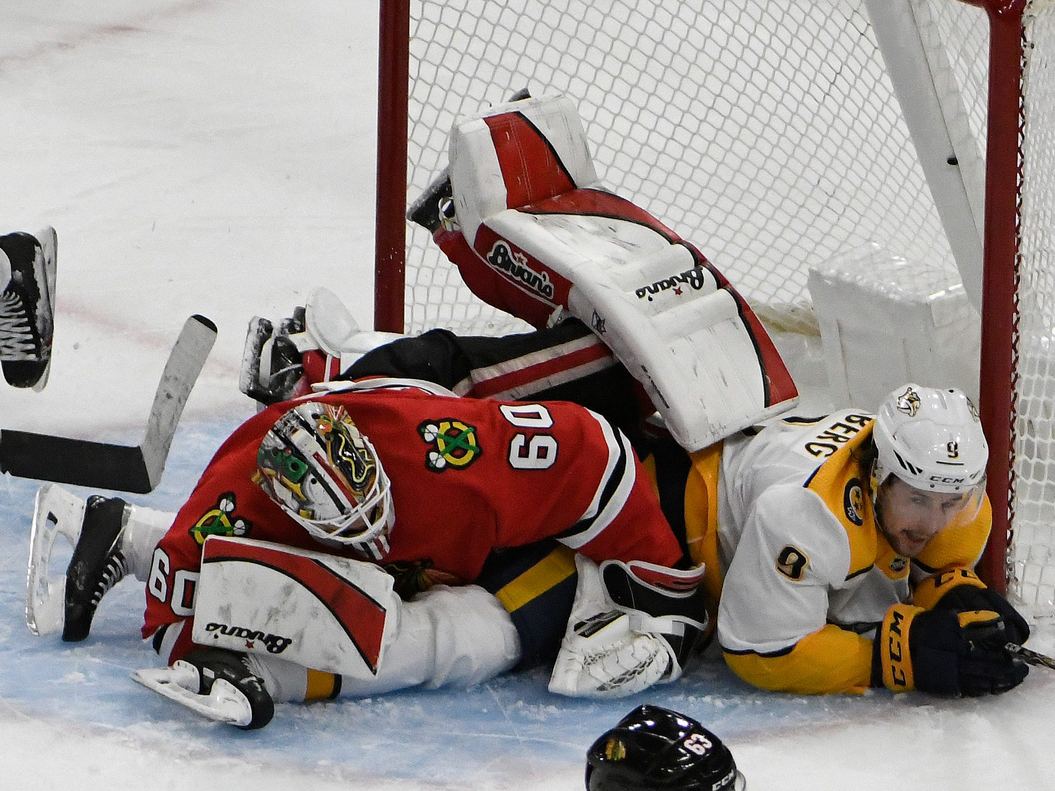 Nashville Predators left wing Filip Forsberg (9) collides with Chicago Blackhawks goaltender Collin Delia (60) during the first period  at United Center.