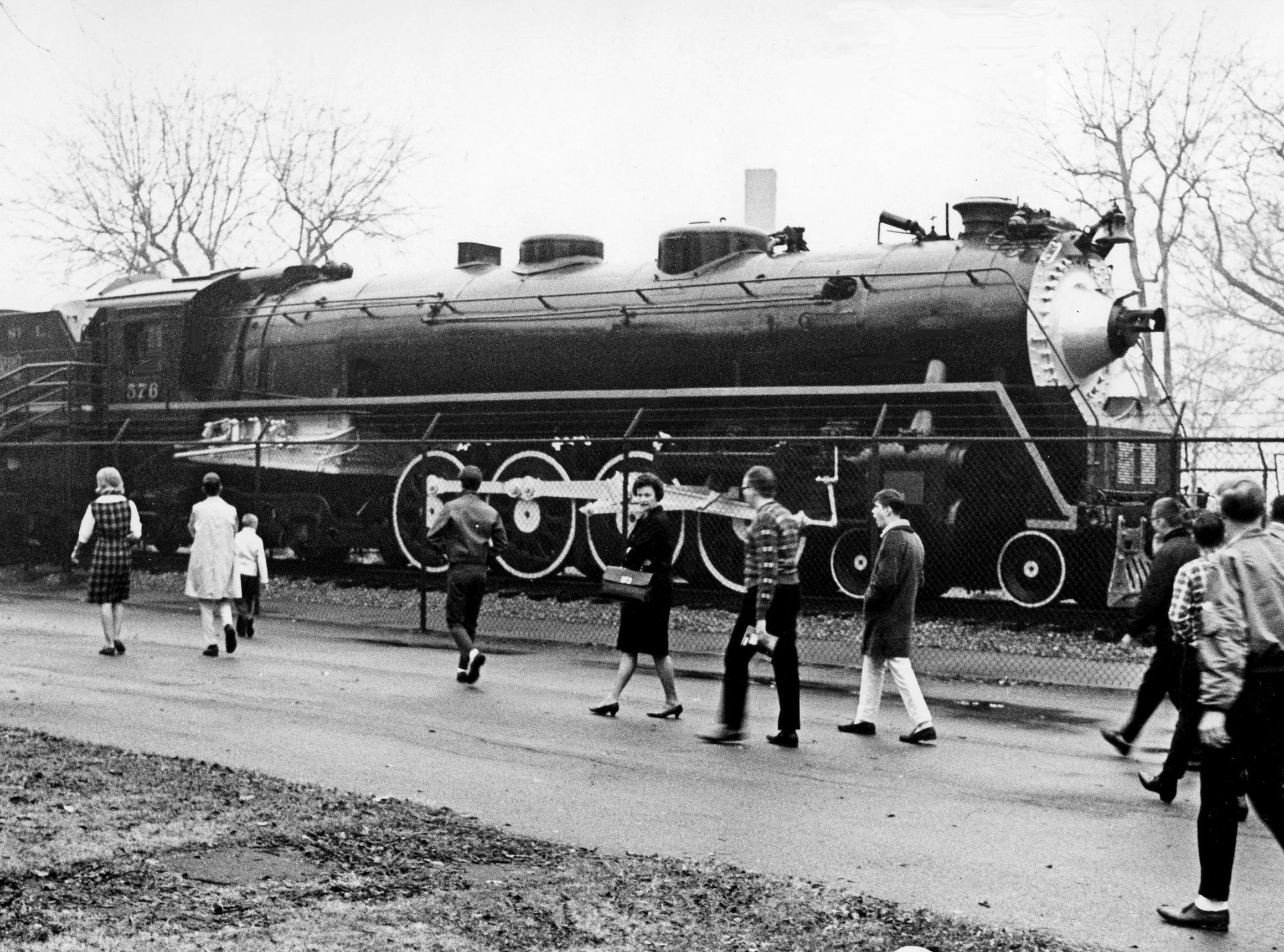 Steam locomotive No. 576, here Jan. 14, 1966, may no longer roll along the tracks, but it can still catch the interests of children, young and old, on a trip to Centennial Park.