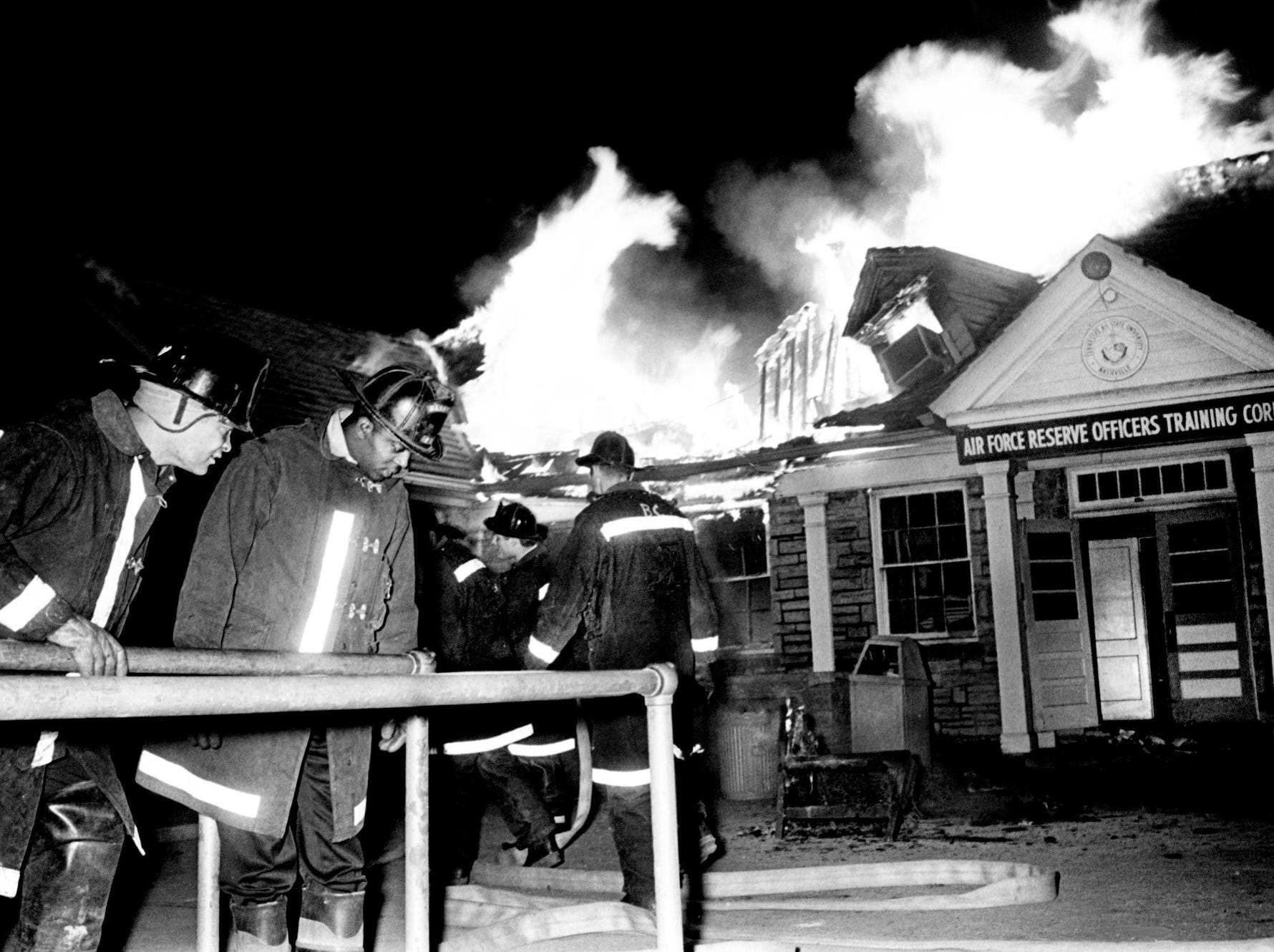 Metro firefighters lay out their hoses to start battling an out-of-control blaze at the Air Force Reserve Officers Training Corps (ROTC) building on the campus of Tennessee A&I State University on April 7, 1968. Metro police said the fire was the apparent work of arsonists.