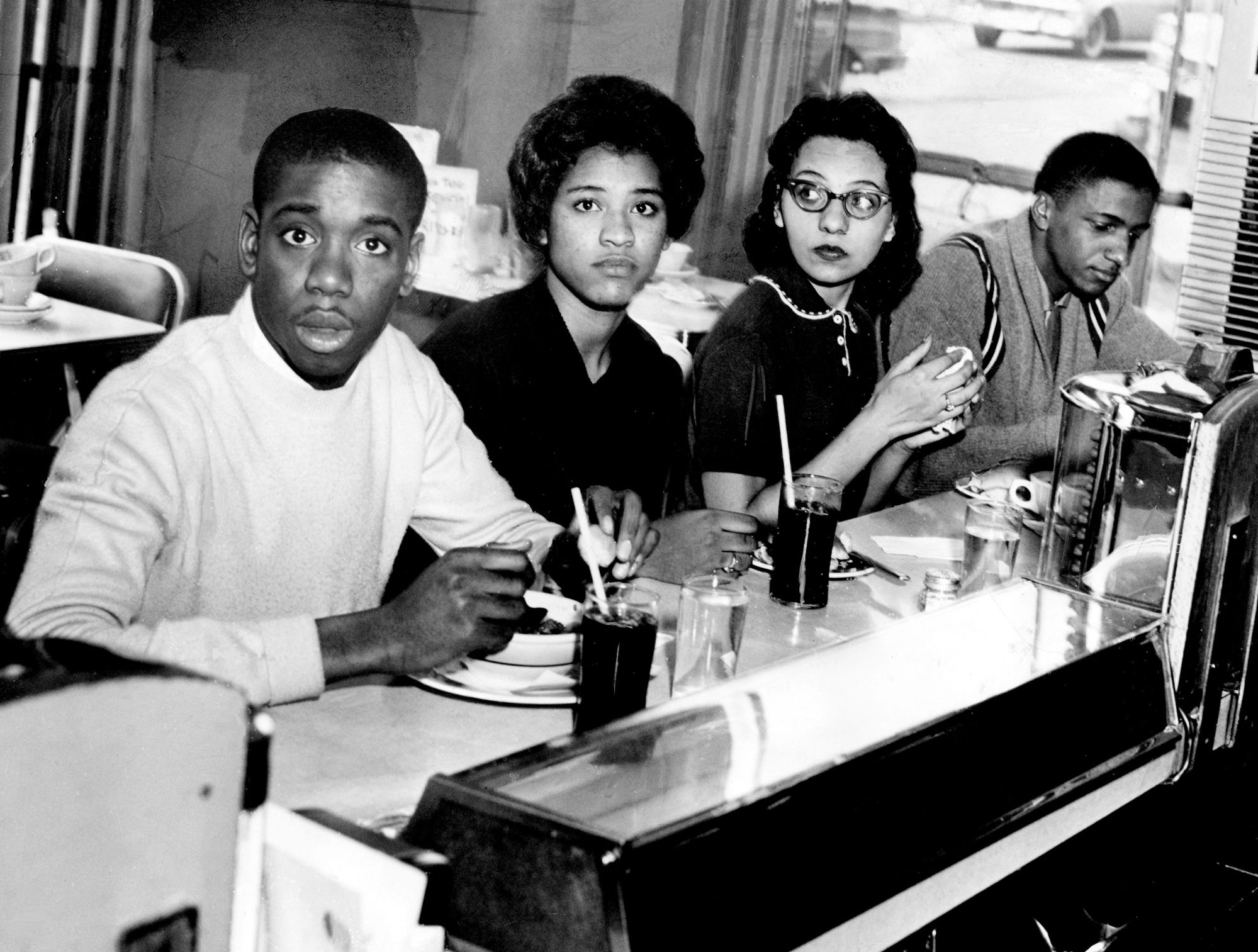 Matthew Walker, left, Peggy Alexander, Diane Nash and Stanley Hemphill eat lunch at the previously segregated counter of the Post House Restaurant in the Greyhound bus terminal March 16, 1960. This marked the first time since the start of the sit-in that blacks were served at previously all-white counters in Nashville.