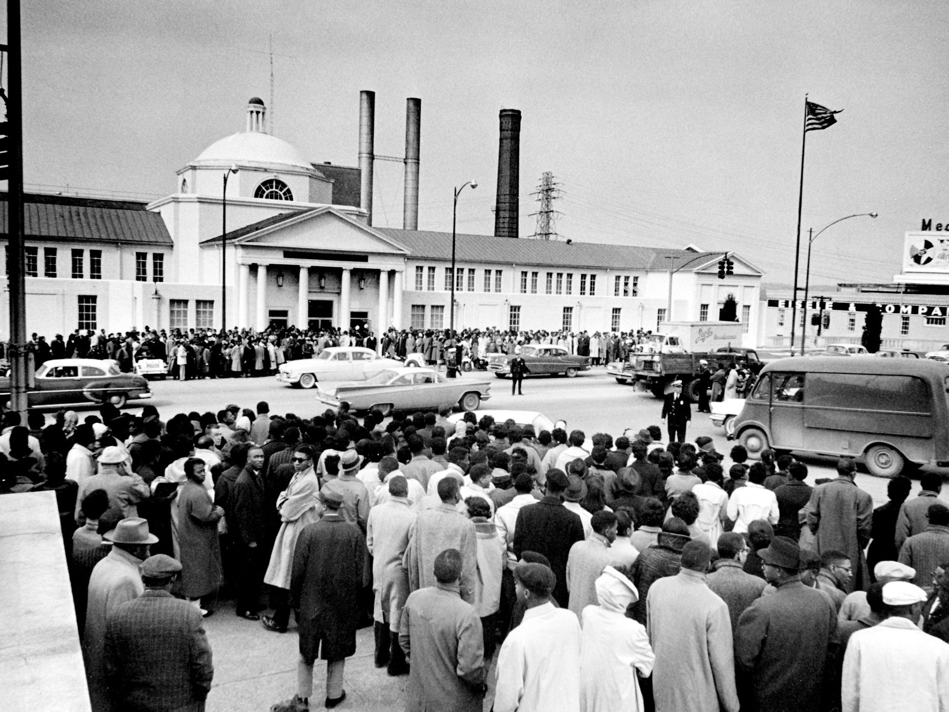 Hundreds jam the sidewalks outside Nashville city court Feb. 29, 1960, where black and white students were being tried on charges stemming from lunch counter demonstrations at five downtown stores. Many in the crowd sang spirituals as they awaited news of the trials. Police estimated the crowd at 2,000.