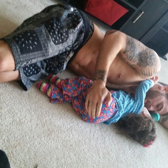 Professional boxer Caleb Plant with his daughter Alia.