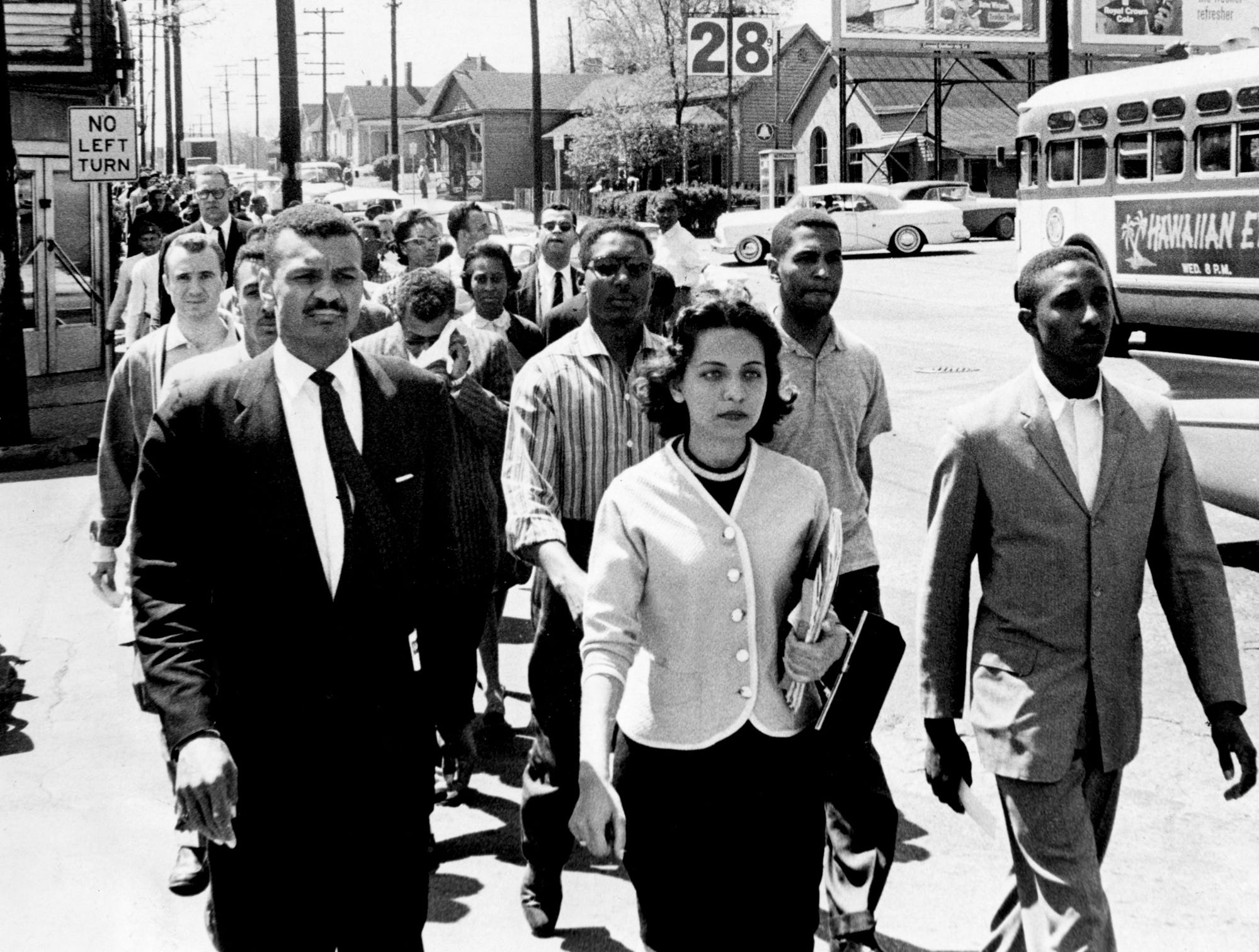 Black leaders march down Jefferson Street at the head of a group of 3,000 demonstrators April 19, 1960. They were headed toward City Hall on the day of the Z. Alexander Looby bombing. In the first row are the Rev. C.T. Vivian, left, Diane Nash of Fisk and Bernard Lafayette of American Baptist Seminary. In the second row are Kenneth Frazier and Curtis Murphy of Tennessee A&I and Rodney Powell of Meharry. Using his handkerchief in the third row is the Rev. James Lawson, one of the advisers to the students. News reporters believed it marked the first time Lawson had participated in a demonstration downtown.