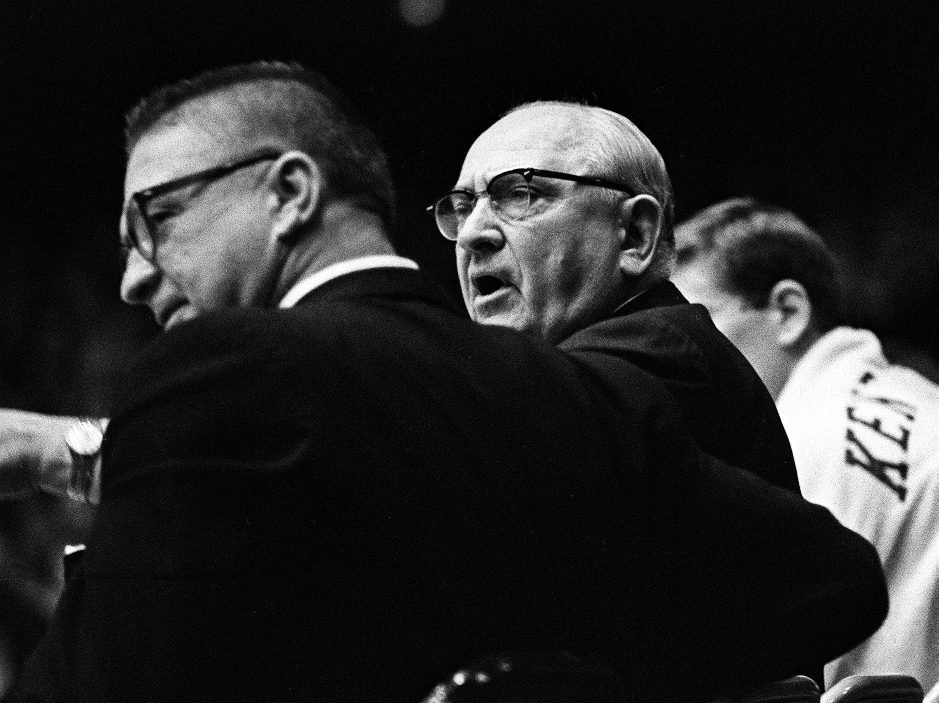 Kentucky head coach Adolph Rupp, right, talks with his assistant coach Harry Lancaster at the start of their game at Vanderbilt. The undefeated Wildcats won 105-90 over the Commodores before more than 9,500 fans in Memorial Gym Feb. 2, 1966.