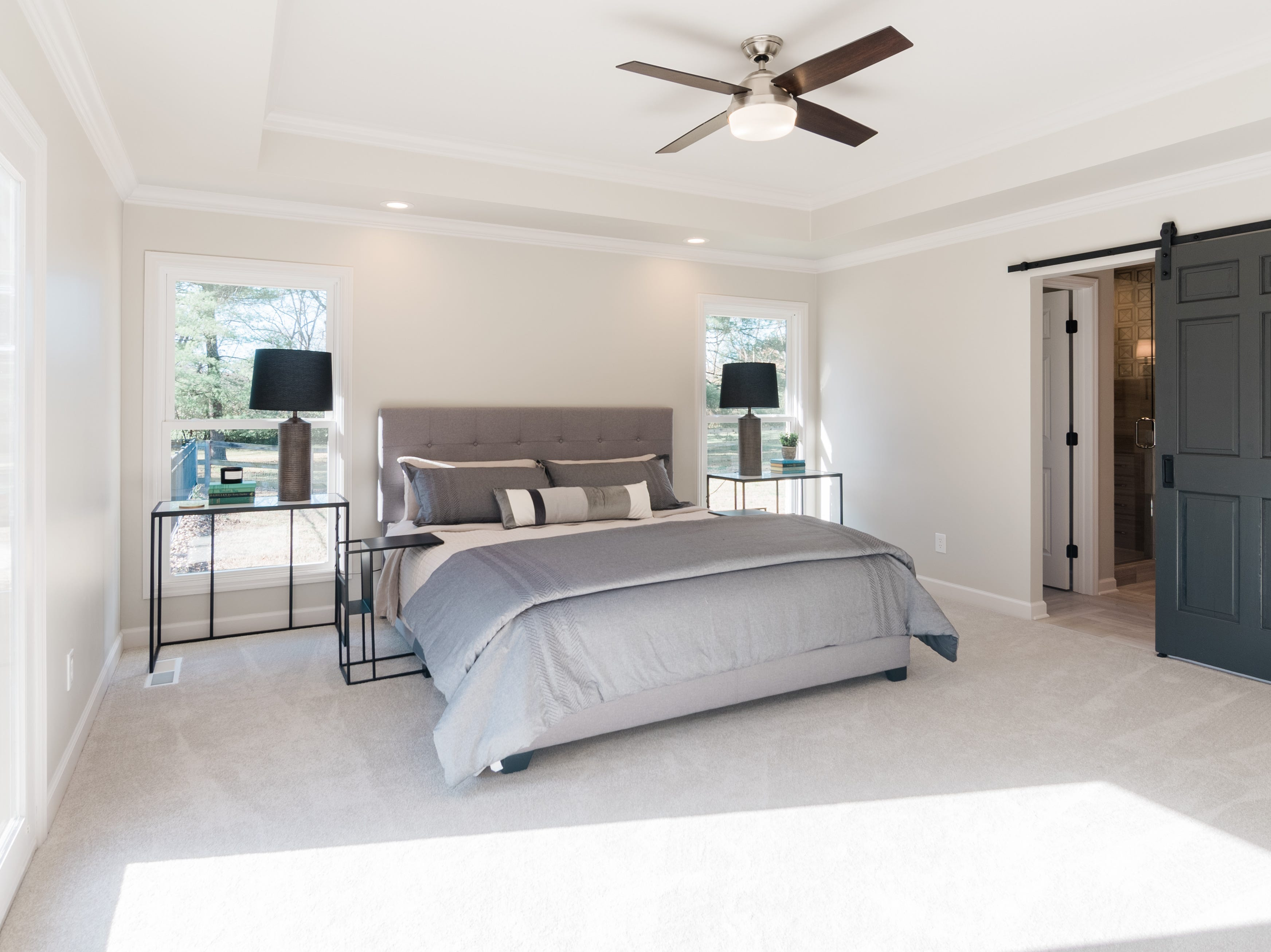 AFTER: The remodeled master bedroom at 405 Oakvale is filled with light.