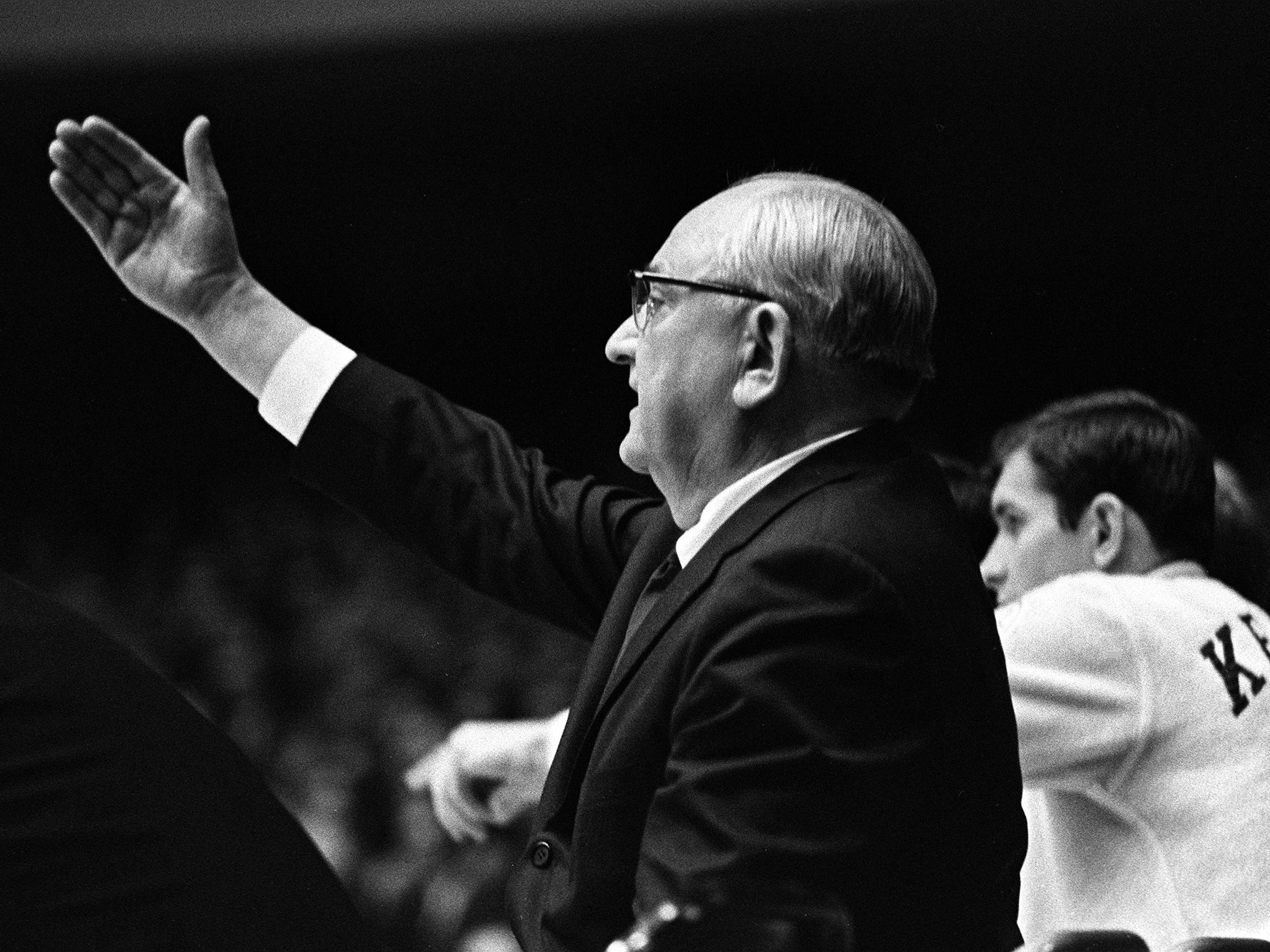 Kentucky head coach Adolph Rupp is giving instructions to his players in their game at Vanderbilt. The undefeated Wildcats won 105-90 over the Commodores before more than 9,500 fans in Memorial Gym Feb. 2, 1966.
