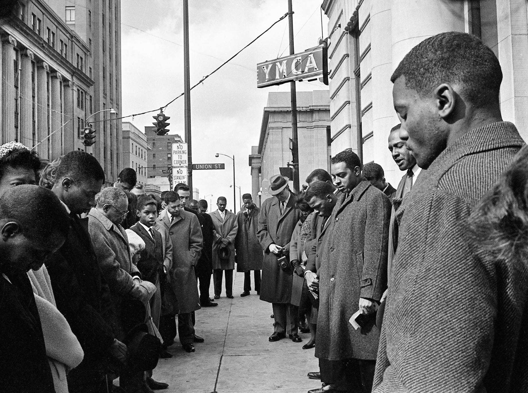 A group of men, women and children gather in front of the downtown YMCA on Feb. 24, 1963, to protest segregation. This group is part of a crowd of about 60 who participated in the demonstration, led by the Nashville Christian Leadership Council. A couple of the student leaders are John Lewis, center on the right side, and Lester McKinnie, right. The group sang hymns and heard prayers from several of the demonstration's leaders.