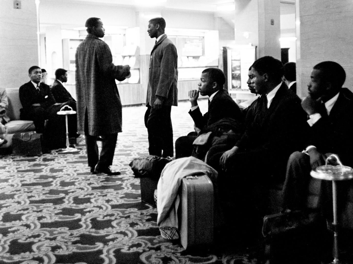 Two dozen black students, including John Lewis, sitting center, attempted to register at the Andrew Jackson Hotel, and when the hotel refused, they sat down in the lobby for the night Feb. 1, 1962. Several white men attending a party in the ballroom went to the balcony and shouted insults at the students. A couple of men tossed their drinks over the rail into the lobby below.