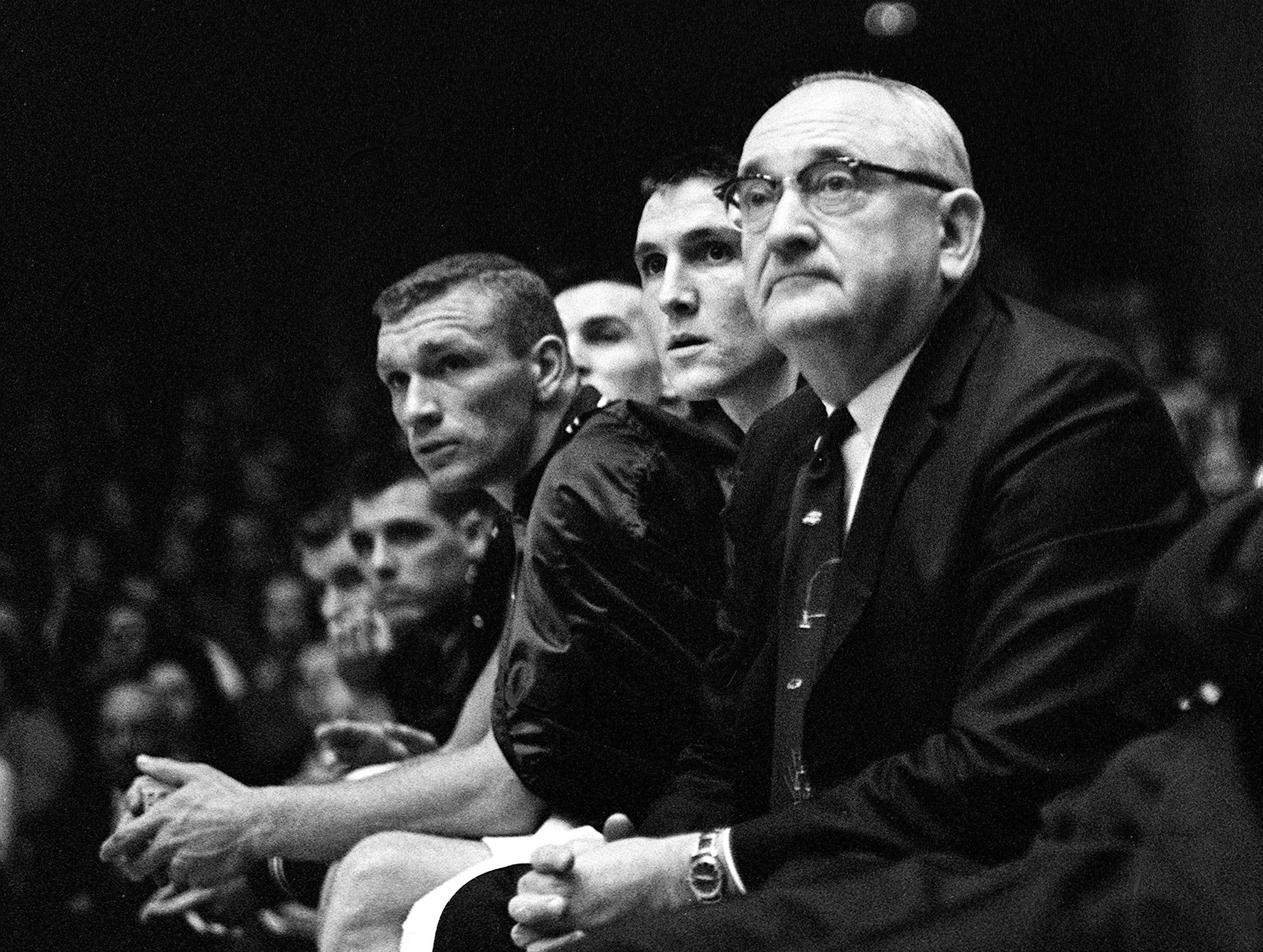 Kentucky head coach Adolph Rupp, right, keeps an eye on his team against Vanderbilt Jan. 9, 1961. The Wildcats became the Commodores' 11th straight victim, falling 64-62 before 7,324 fans at Memorial Gym in Nashville.