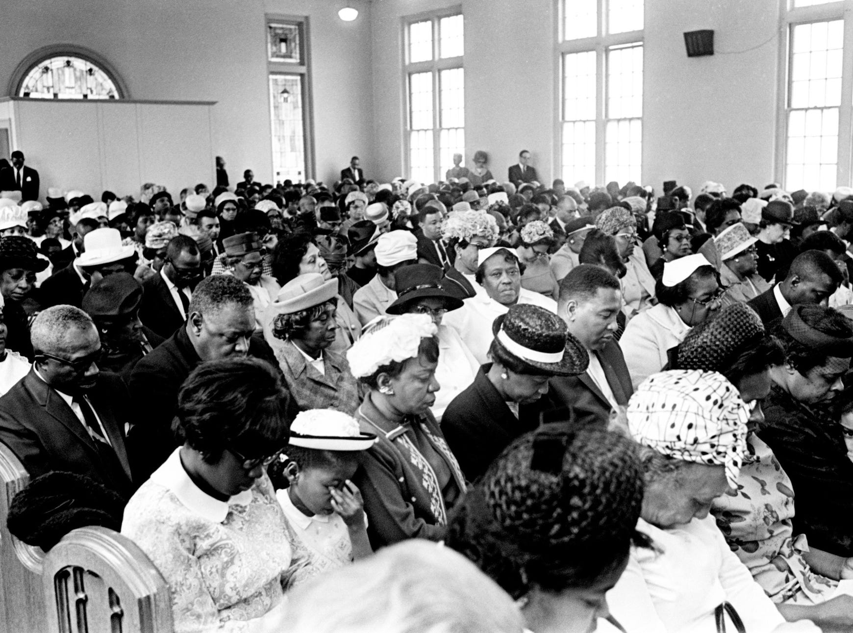 A packed house of 1,500 people pray during an interracial, interdenominational memorial service for the Rev. Martin Luther King Jr. at Gordon Memorial Church in Nashville on April 7, 1968.