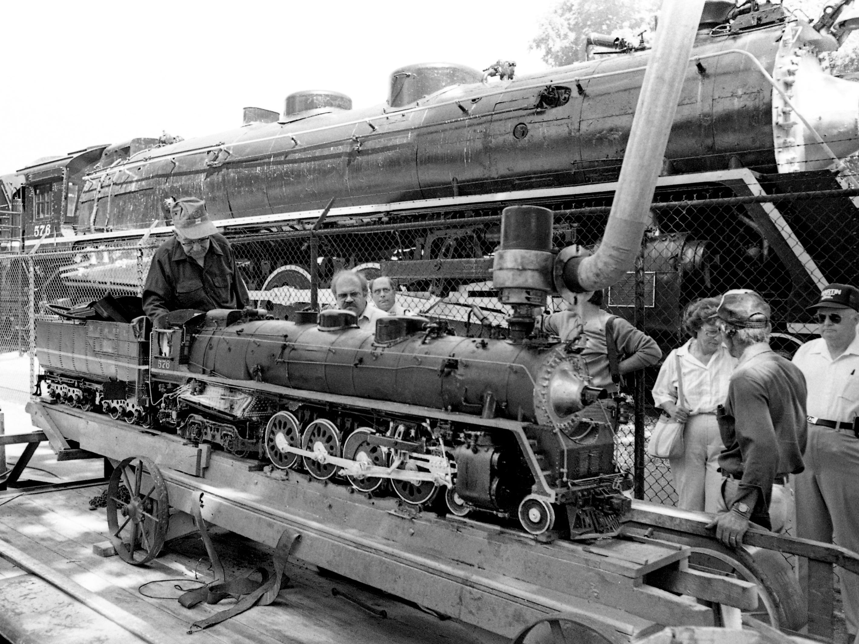 Cheatham County train buff Ernest Williams, 82, left, displays the scale model next to the real one, the Locomotive No. 576, on display at Centennial Park June 6, 1987. The Pleasant View, Tenn. resident says the nine years it took to make the model was a labor of love.
