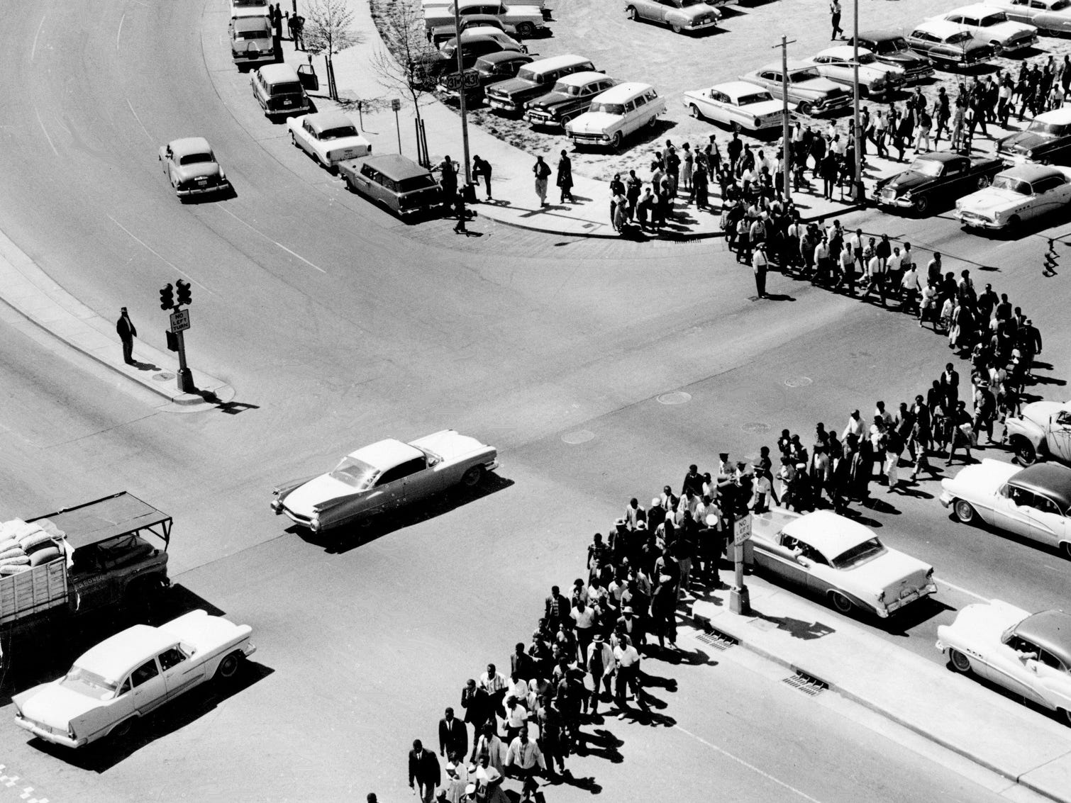 A line of black college demonstrators wends its way around the courthouse area, coming out from Jefferson Street and James Robertson Boulevard, on April 19, 1960. The line of students, marching three abreast, stretched 10 blocks.