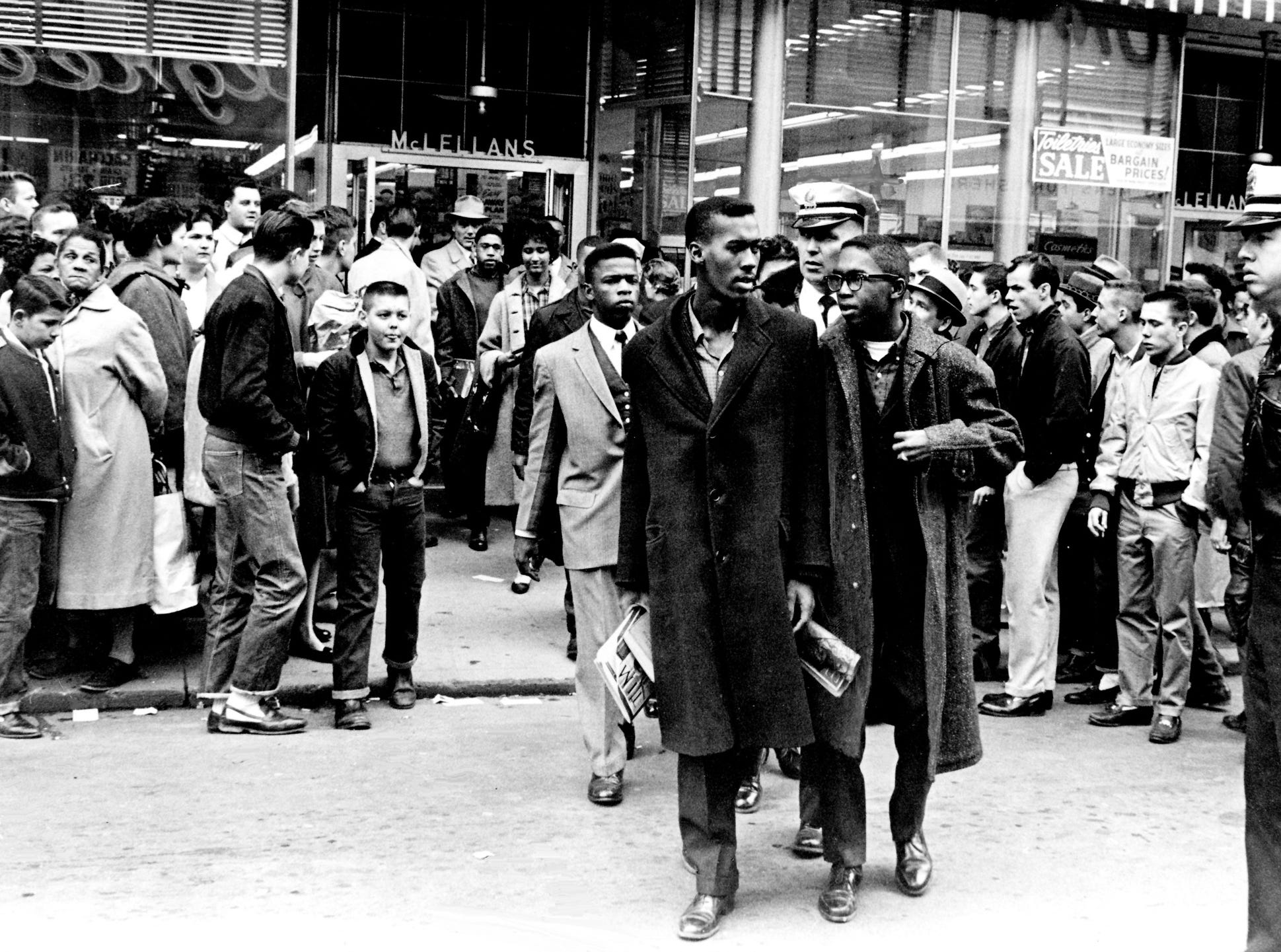 Black demonstrators, including John Lewis, center in light suit, are hustled out of McLellans Variety Store on Fifth Avenue North in downtown Nashville and off to jail after a four-hour demonstration against lunch counter segregation Feb. 27, 1960.