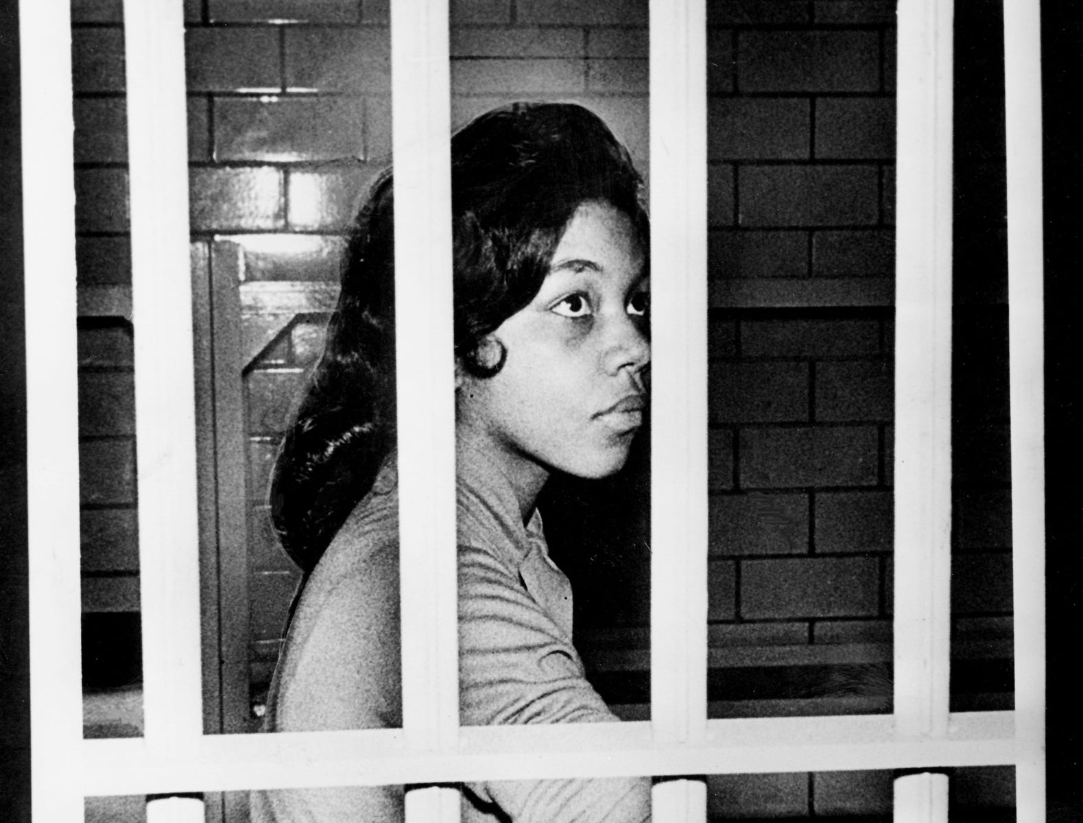 Jean Wynona Fleming, a Fisk University student, sits behind bars in Nashville city jail March 25, 1960, after her arrest at a downtown Moon-McGrath drugstore lunch counter. Black students resumed their protests against segregated eating facilities with sit-in demonstrations at nine restaurants.