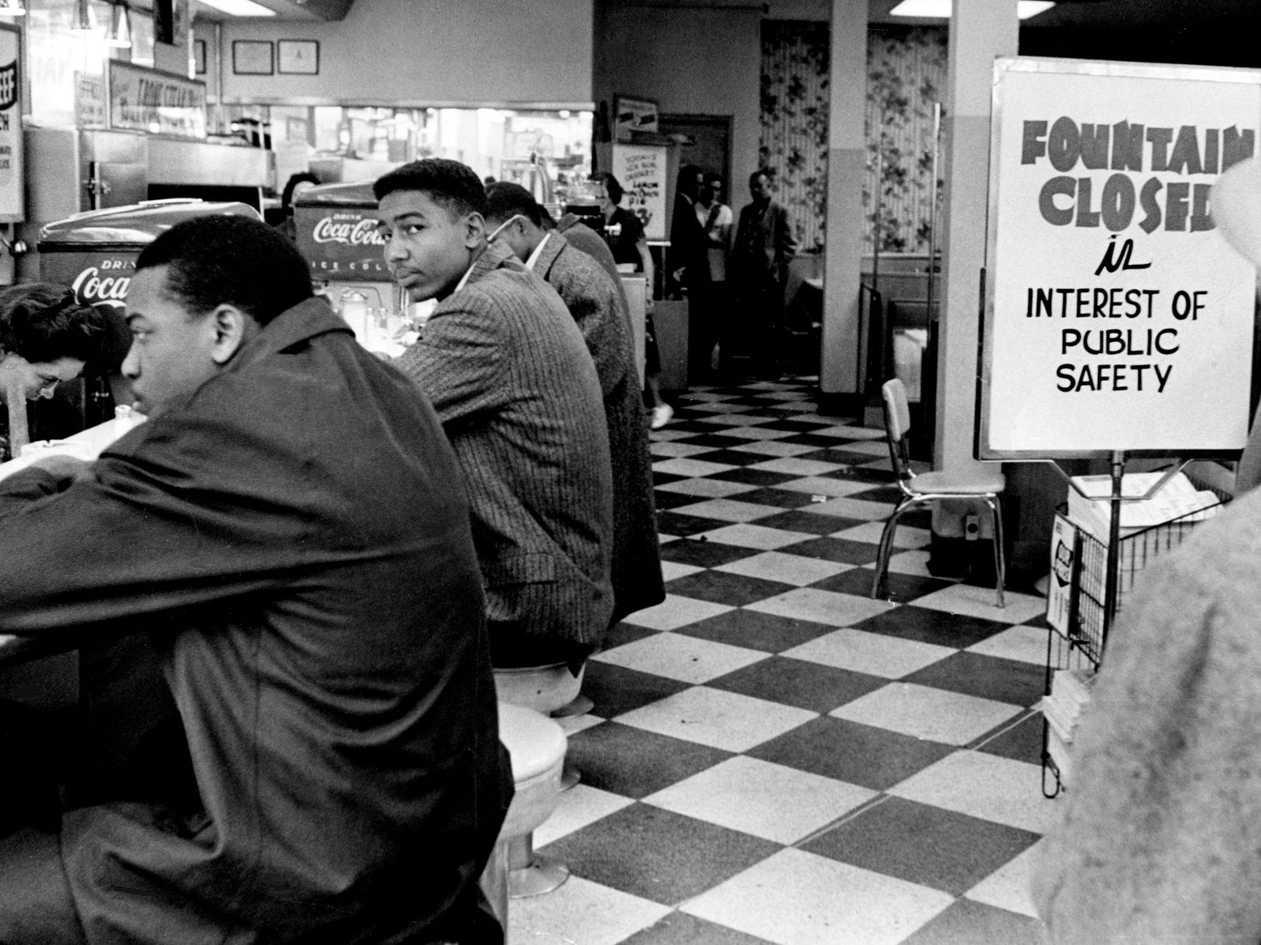 Black students, including John Hardy, left, and Curtis Murphy, sit as a closed sign went up immediately when they attempted to get served at the lunch counter of Walgreen's drugstore on Fifth Avenue and Arcade in downtown Nashville on Feb. 20, 1960. Luther Harris, a Fisk student who acted as spokesman for the group, said it was the first effort in the South to desegregate drugstore facilities.