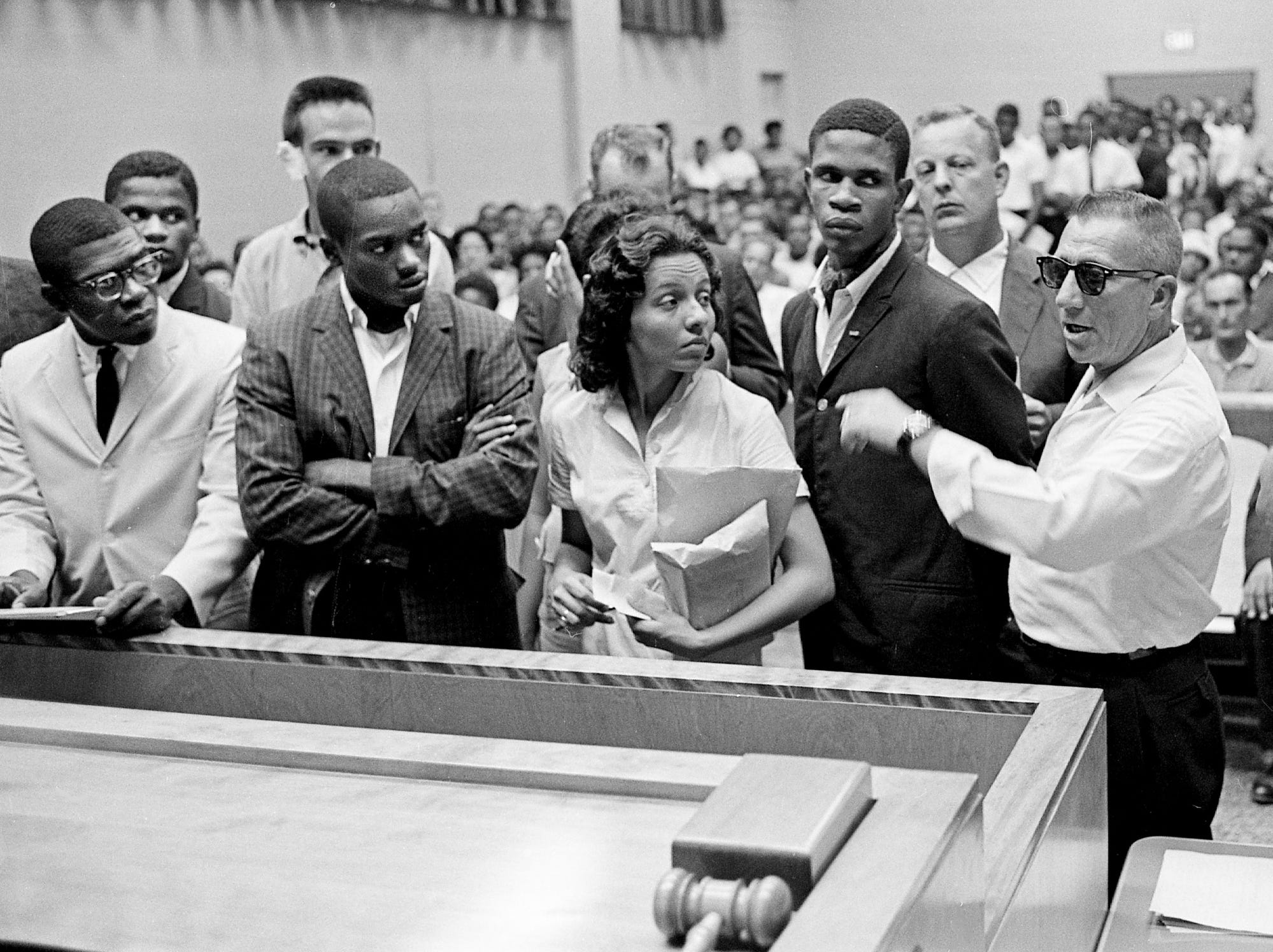 "Some of the seven blacks arrested after a racial clash with a group of white youths as they picketed an H.G. Hill store face the judge in Nashville City Court on Aug. 7, 1961. Diane Nash, center, a leader in the demonstration, said she preferred to stay in jail because ""it's ridiculous when the police arrest the innocent party."""