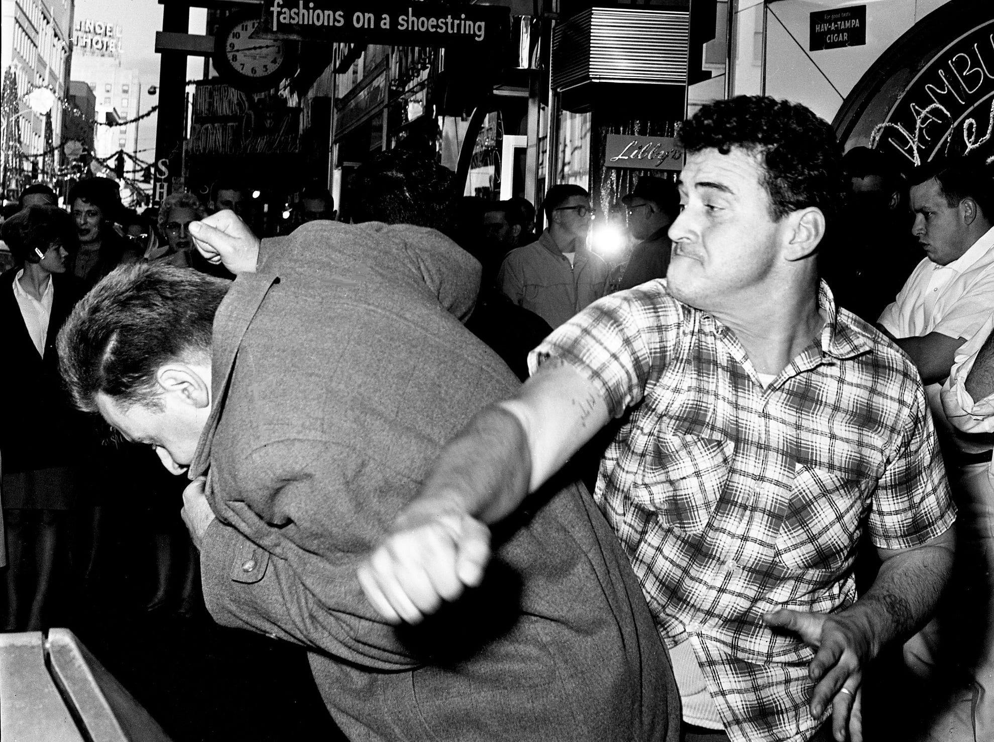 Dr. David Kotelchuck, left, assistant professor of physics at Vanderbilt University and a member of a sit-in group, ducks as restaurant employee Bobby Gene Taylor swings at him during a demonstration in front of Herschel's Tic Toc restaurant on Church Street on Dec. 8, 1962. Nashville Police arrived a few minutes later and things simmered down.
