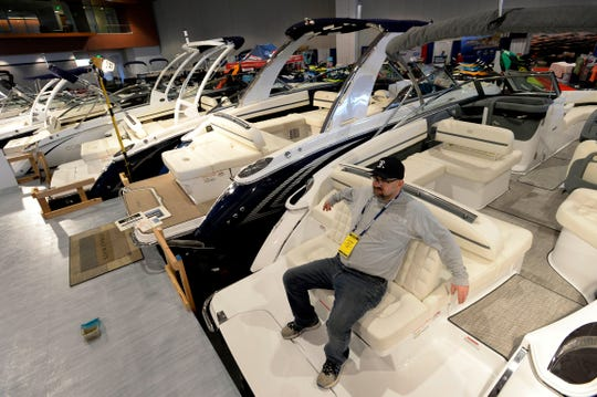 Eric Rubash takes a break from cleaning several Cobalt stern drive boats from Modern Marine in Nashville in preparation for the Nashville Boat Show at the Music City Center Wednesday, Jan. 9, 2019, in Nashville, Tenn.