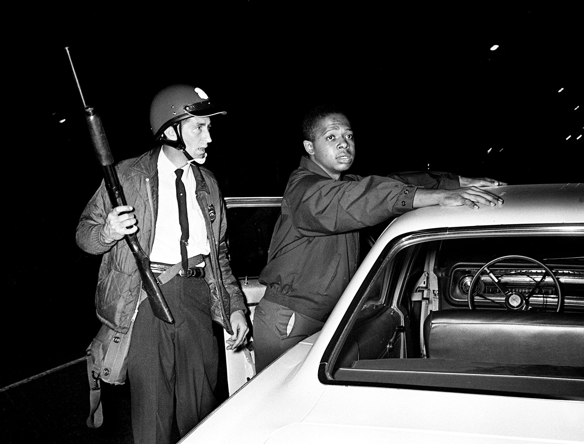 A Metro police officer, left, checks out a suspect near the Tennessee State University campus on Jefferson Street on April 9, 1967. Rock throwing escalated to gunfire as violence erupted, sending mobs and riot police swarming through North Nashville's black community.